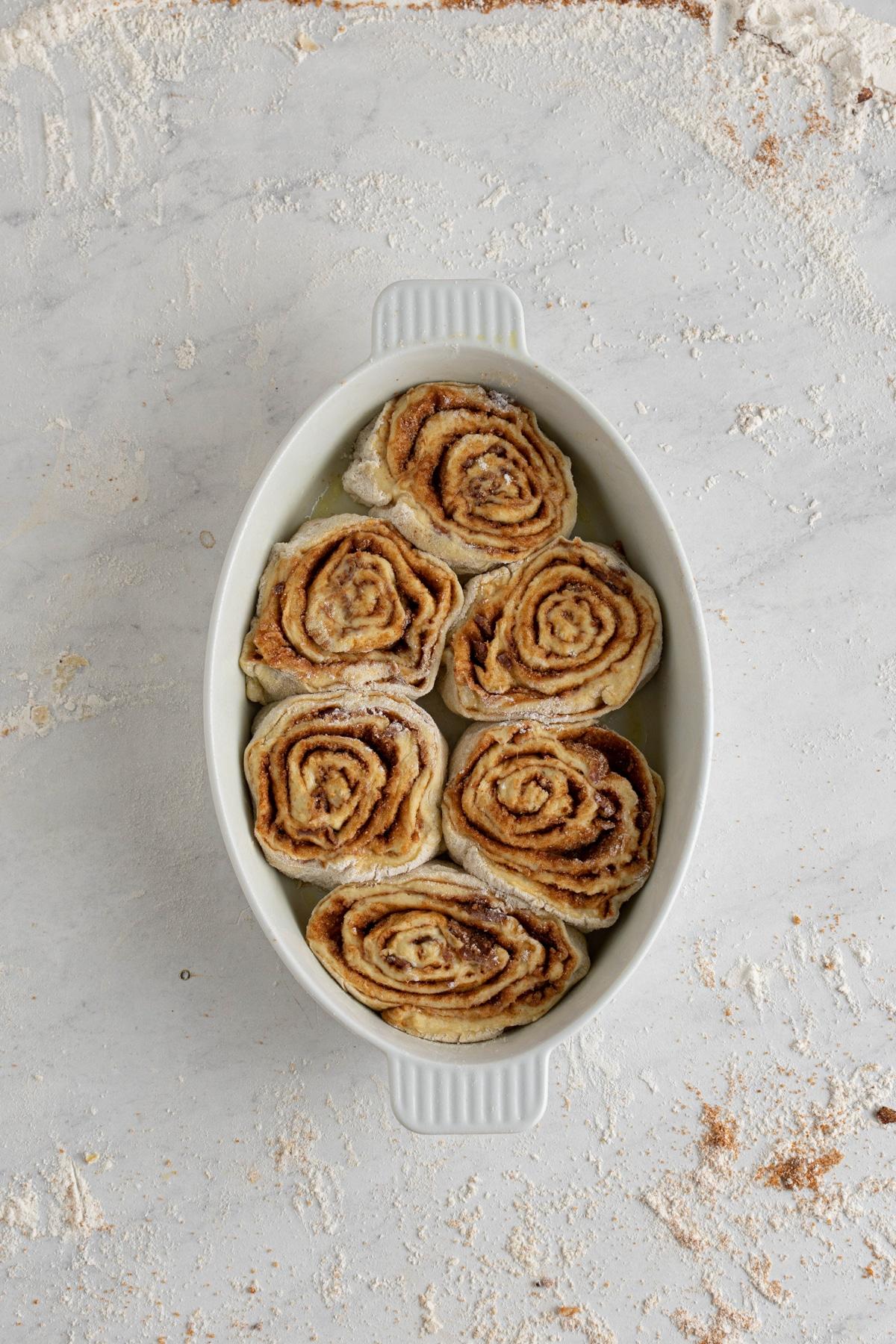 bacon cinnamon rolls in a baking wish