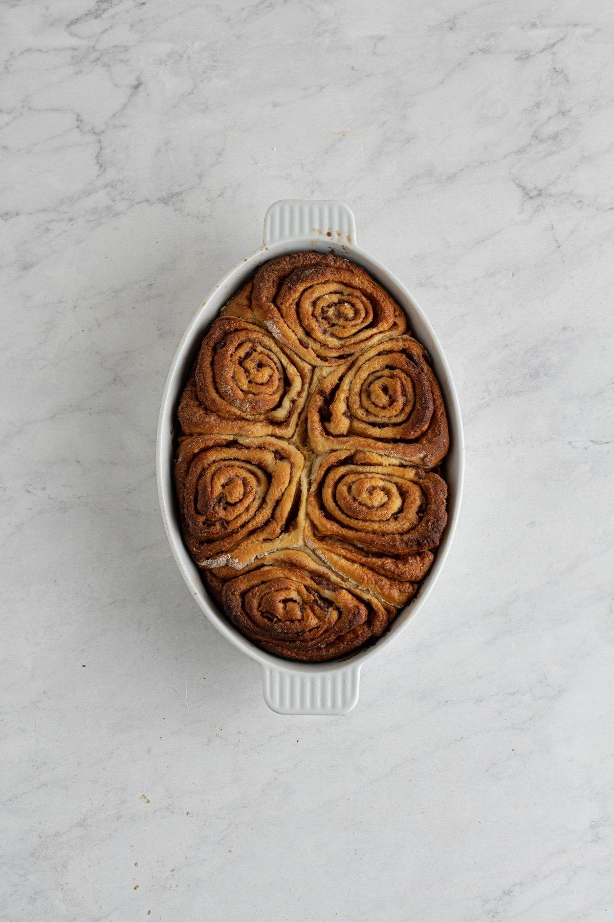 baked bacon cinnamon rolls in a baking dish