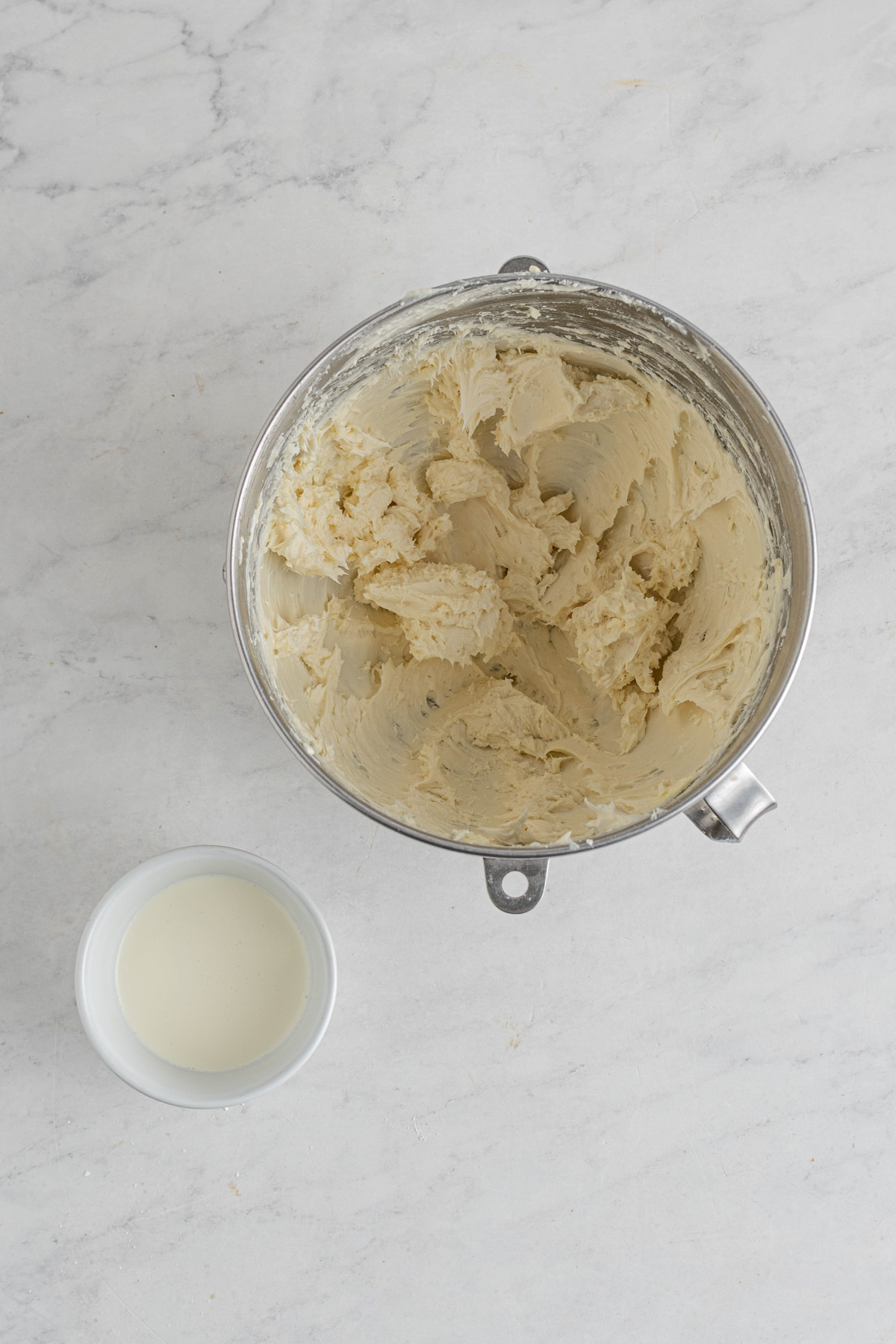 cream cheese cinnamon roll frosting in a metal mixing bowl