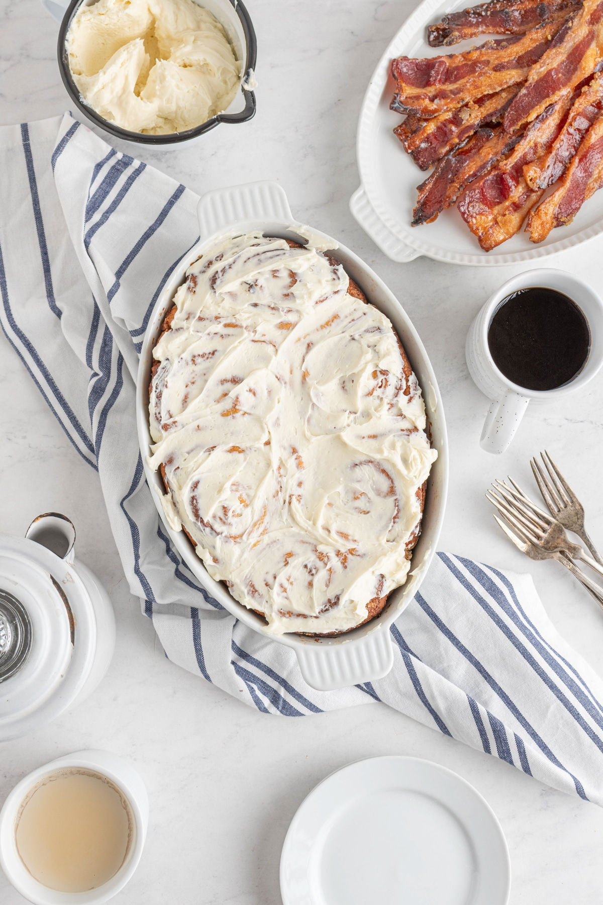 bacon cinnamon rolls with frosting on top