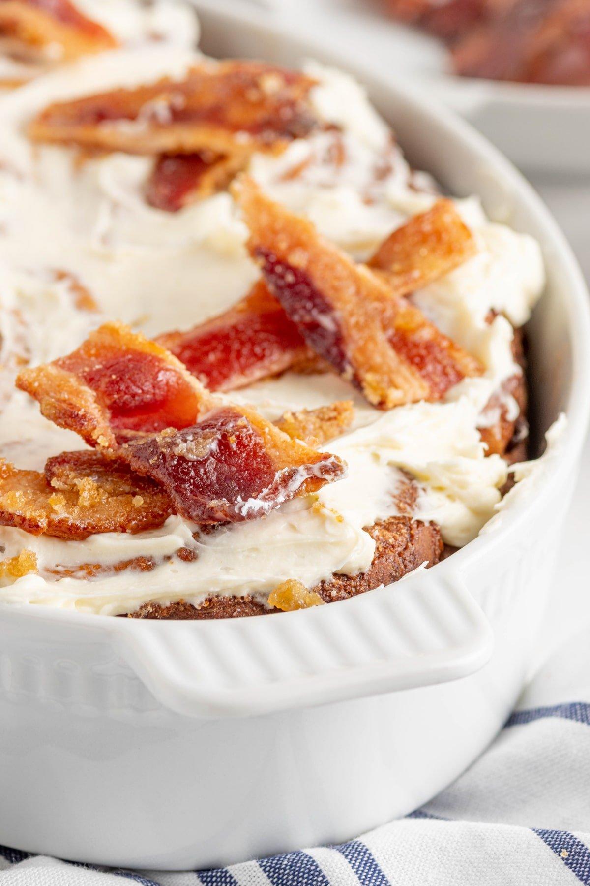 Bacon cinnamon rolls in a white baking dish