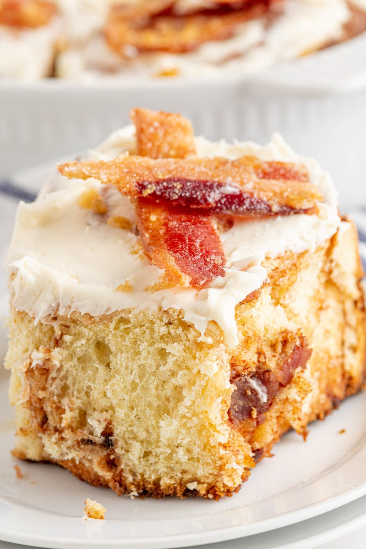 Bacon cinnamon roll with candied bacon on top