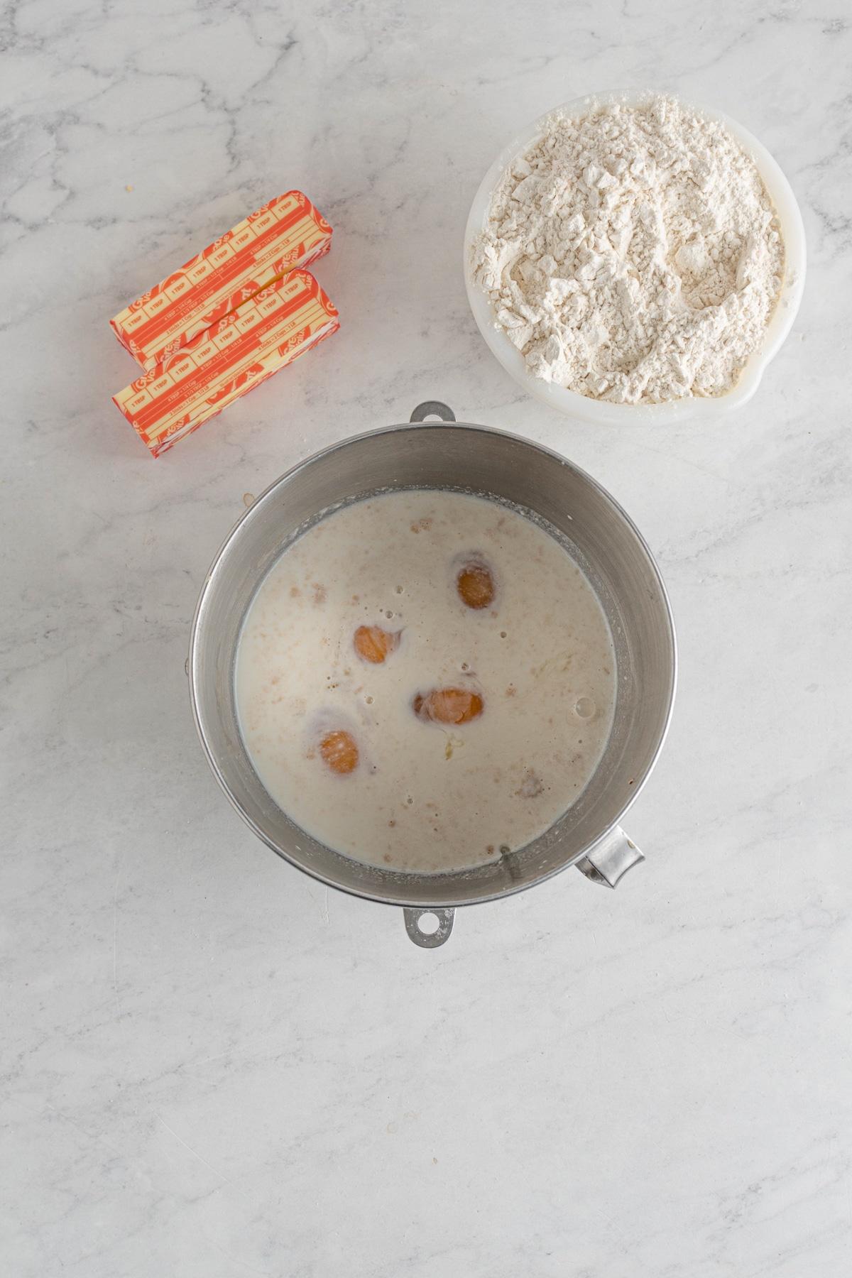 milk warmed in a metal bowl