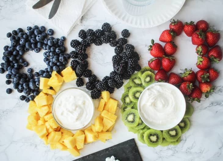 Rings made out of fresh fruit with dip in the middle