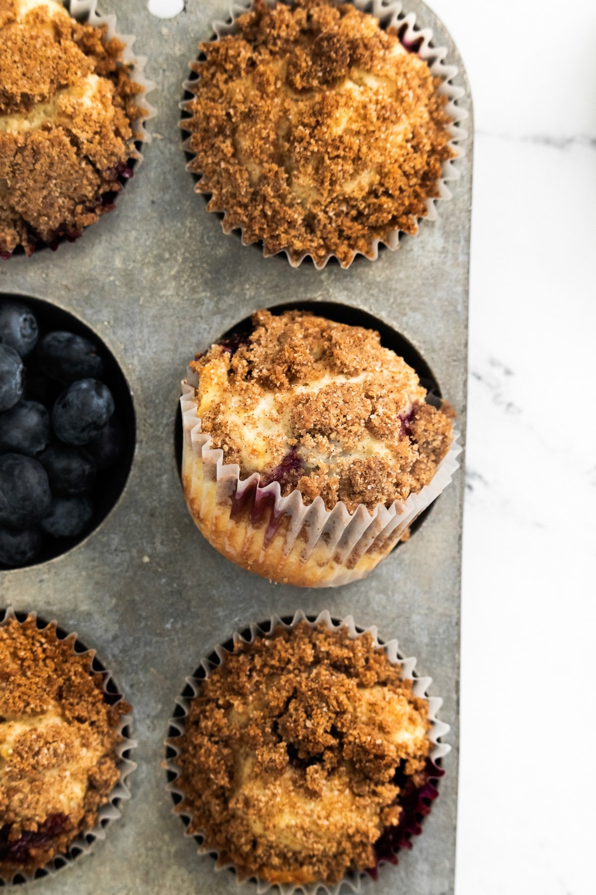 muffin tin with lemon blueberry muffins