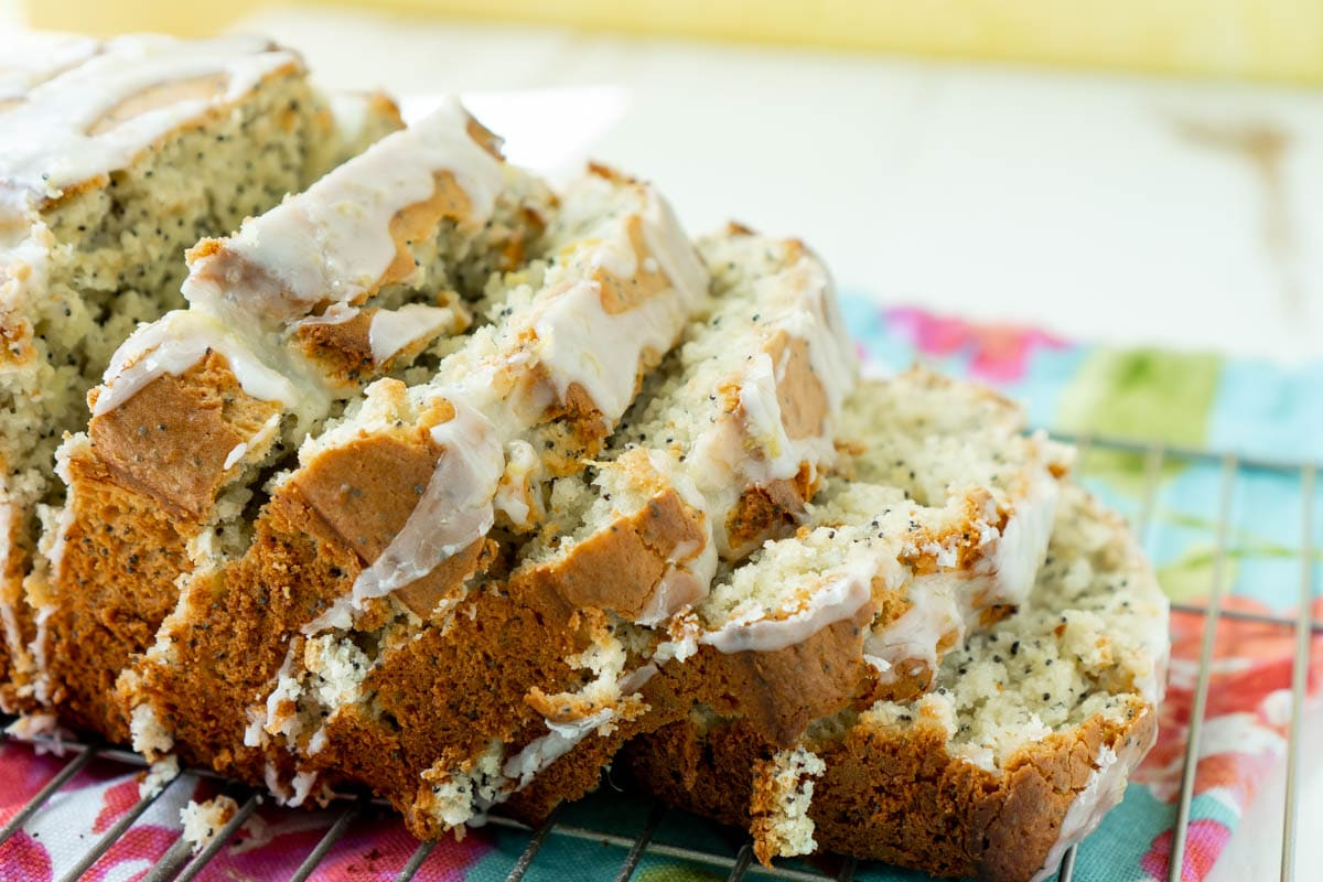 sliced loaf of lemon poppy seed bread with glaze