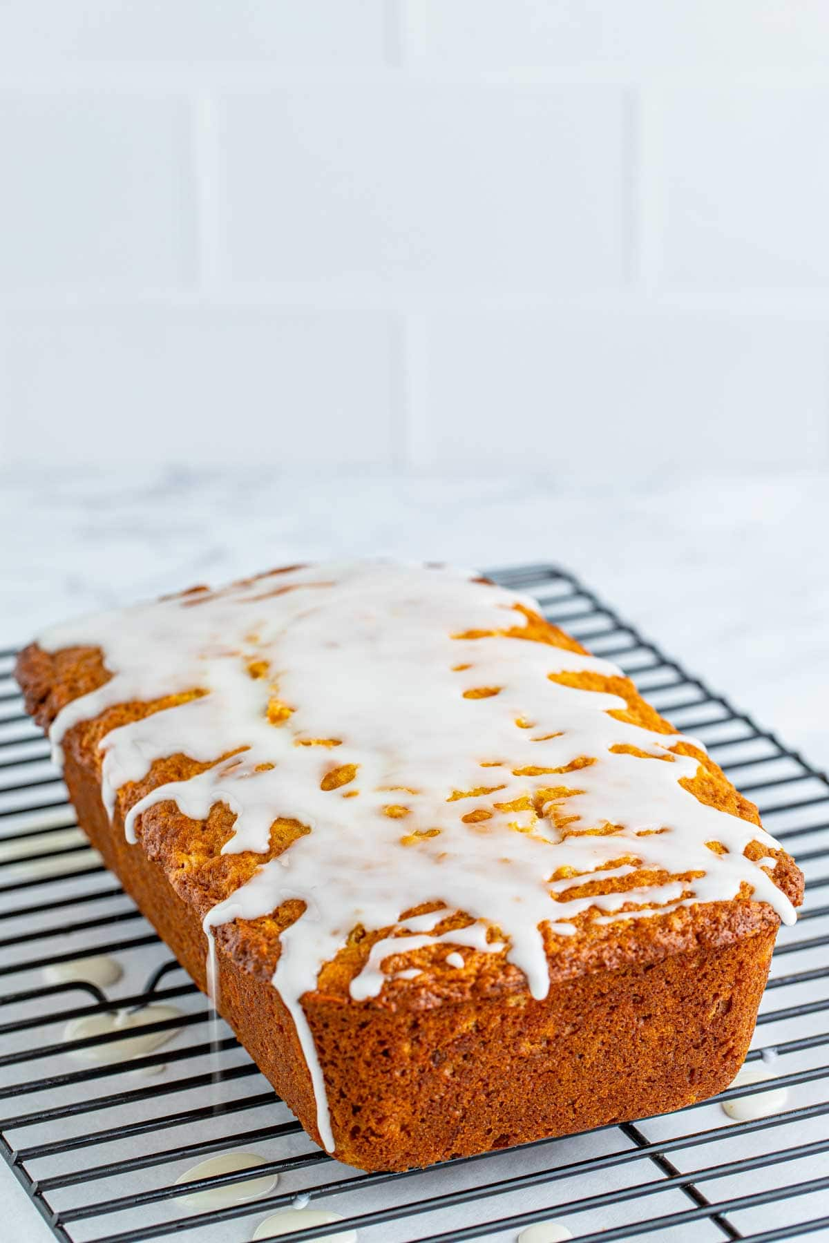 pineapple bread with glaze on top of a wire rack