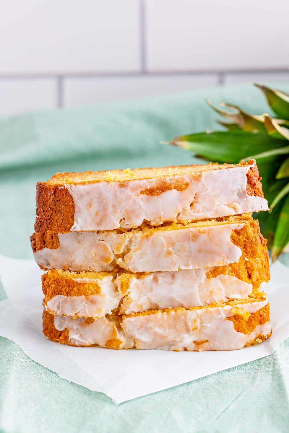 slices of pineapple bread stacked on a white plate
