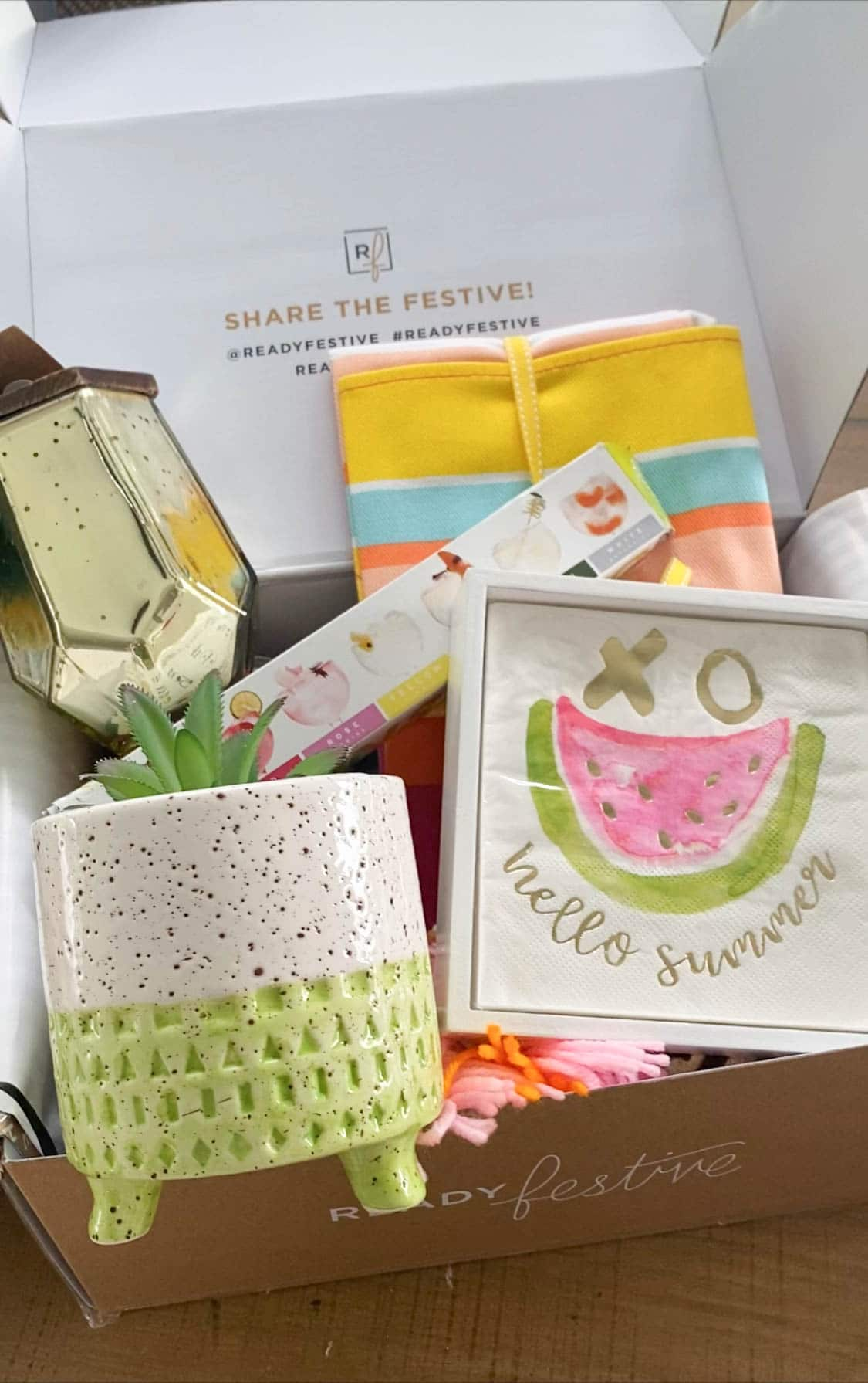 box filled with summer decorating items