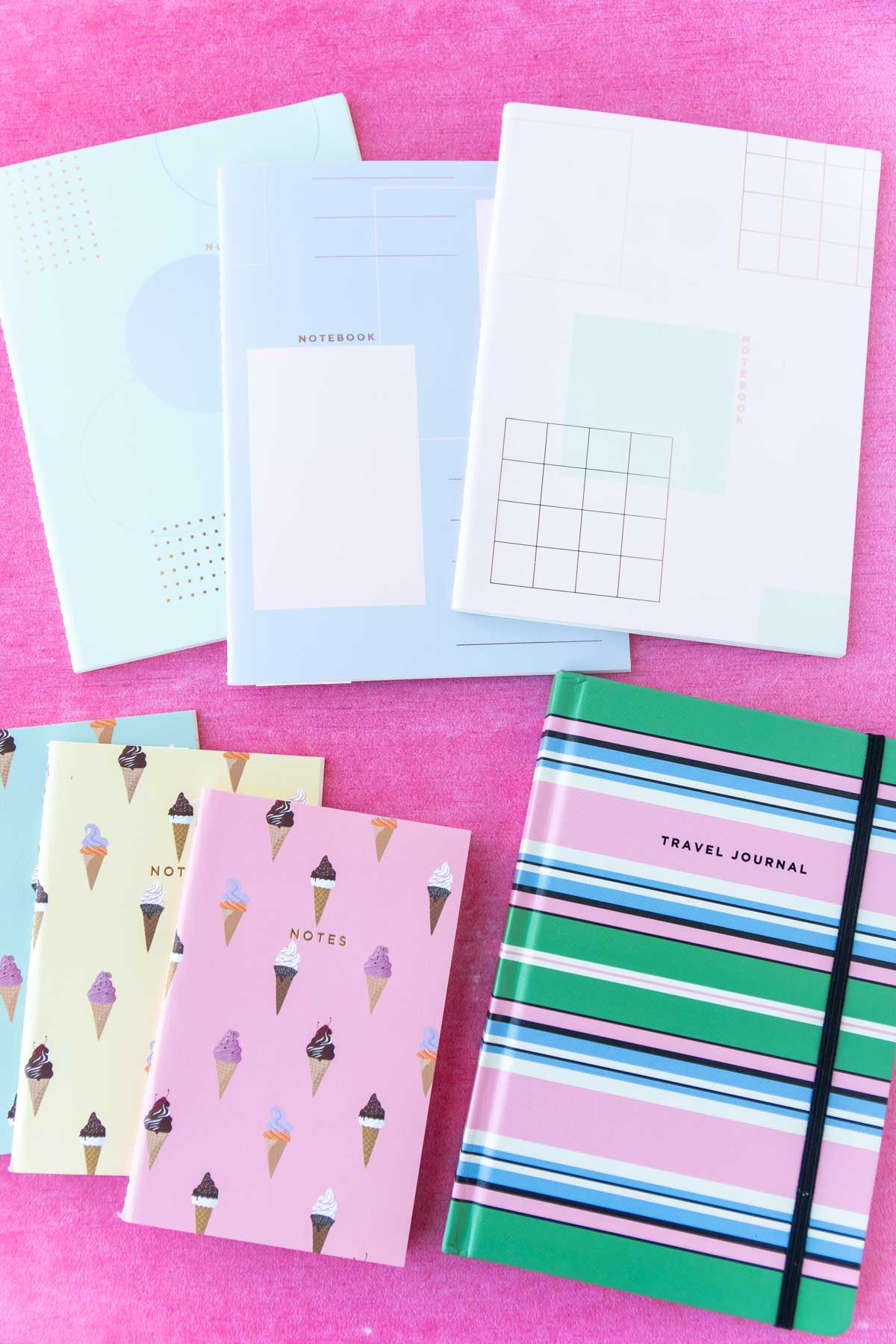 colorful notebooks and planners in a pile