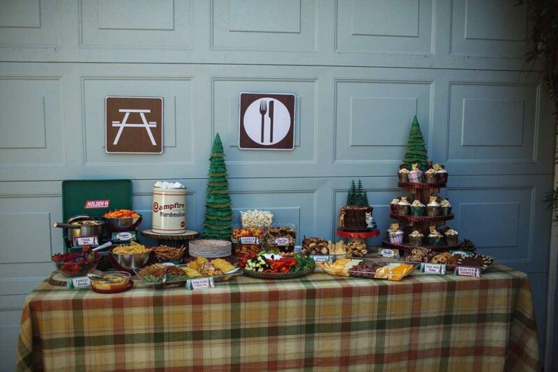 Plaid tablecloth with camping party food on top
