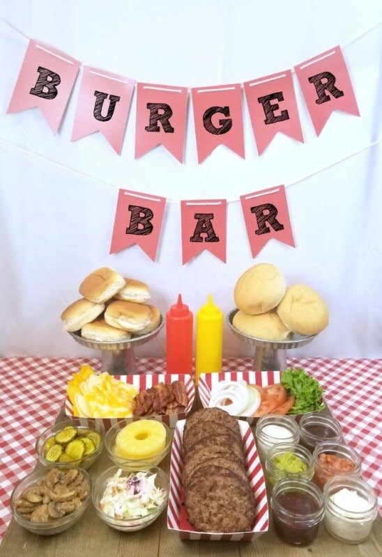 burger bar setup with all the toppings