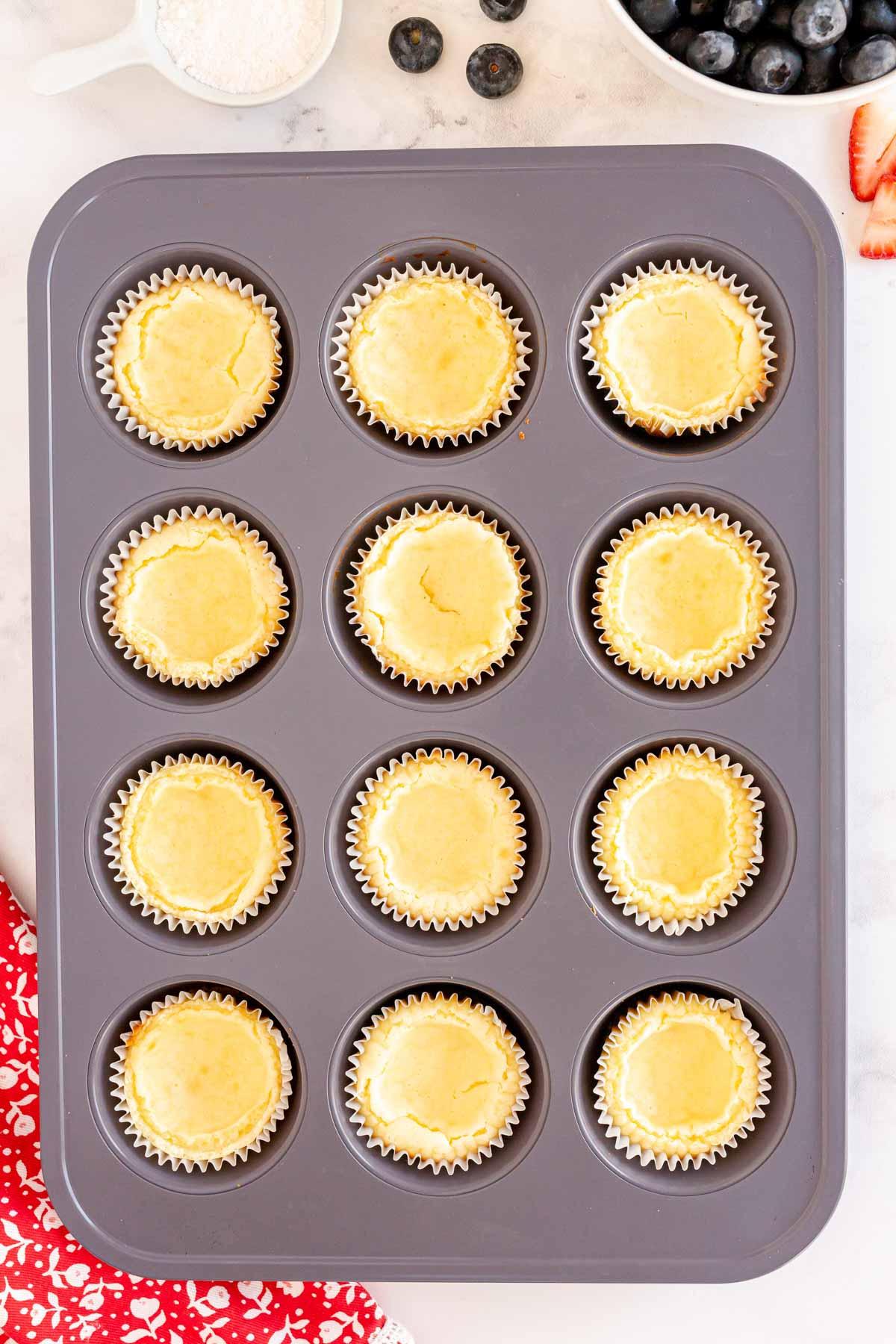 mini cheesecake in a muffin tin