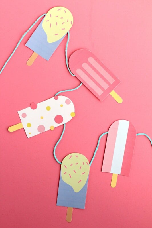 Popsicle garland on a pink background
