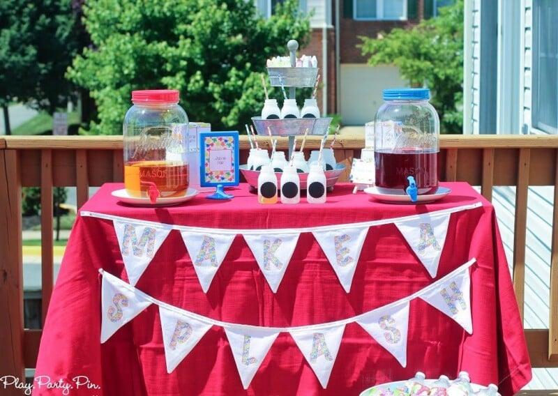 Juice bar setup on a red table