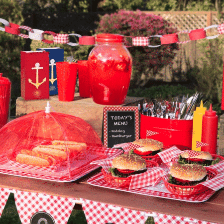 Table with hamburgers and hot dogs