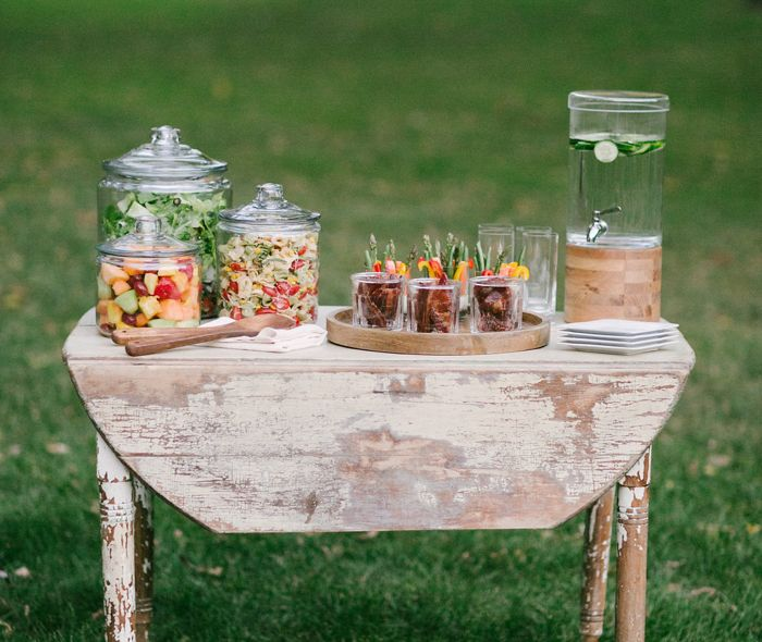 Table with salads with a grass background