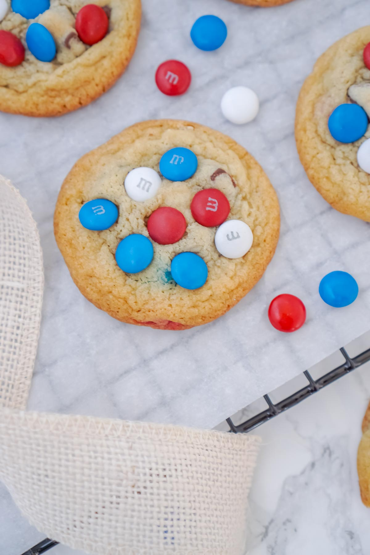 chocolate chip M&M cookies cooling on a wire rack