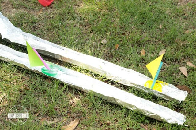 Tin foil with homemade boats on it