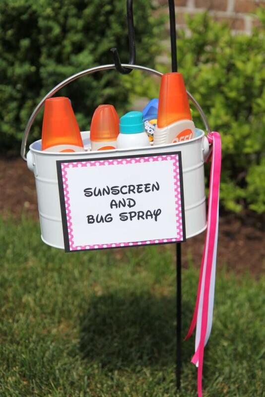 Sunscreen and bug spray in a tin hanger