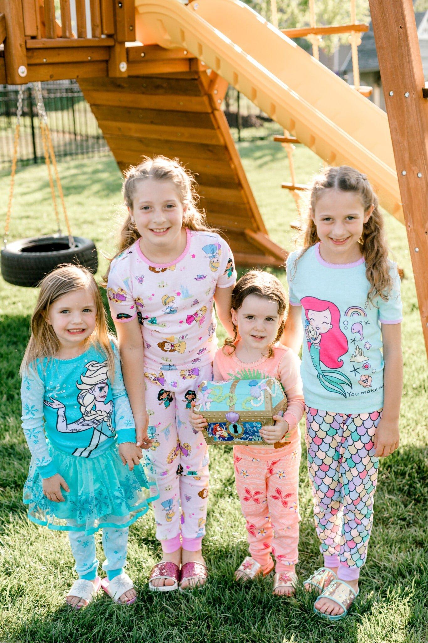 girls standing together in princess pajamas
