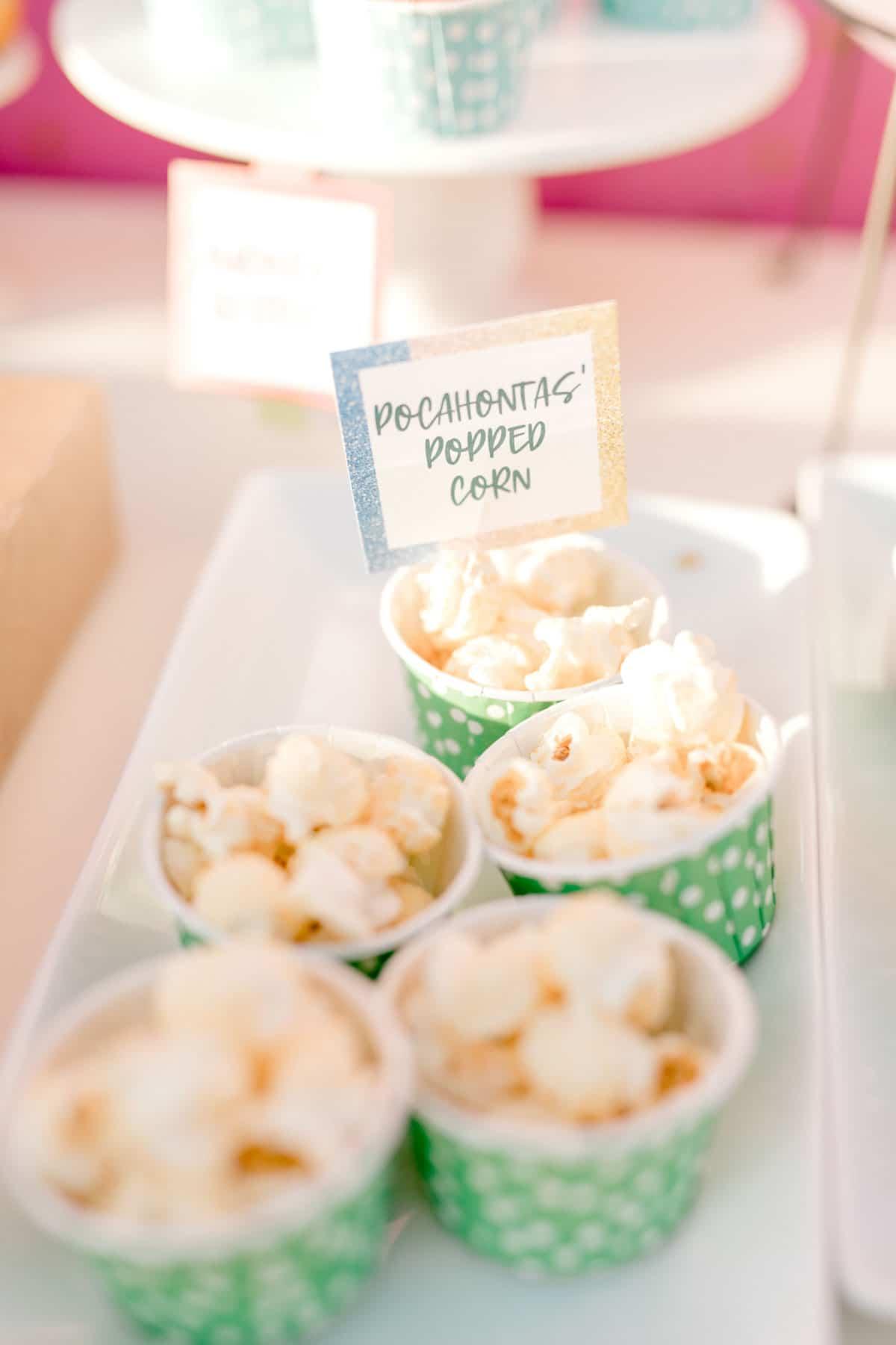 green cups full of popcorn