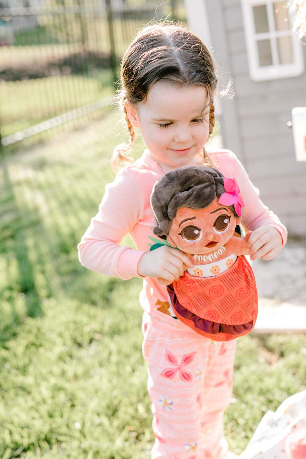 girl holding a MOana baby
