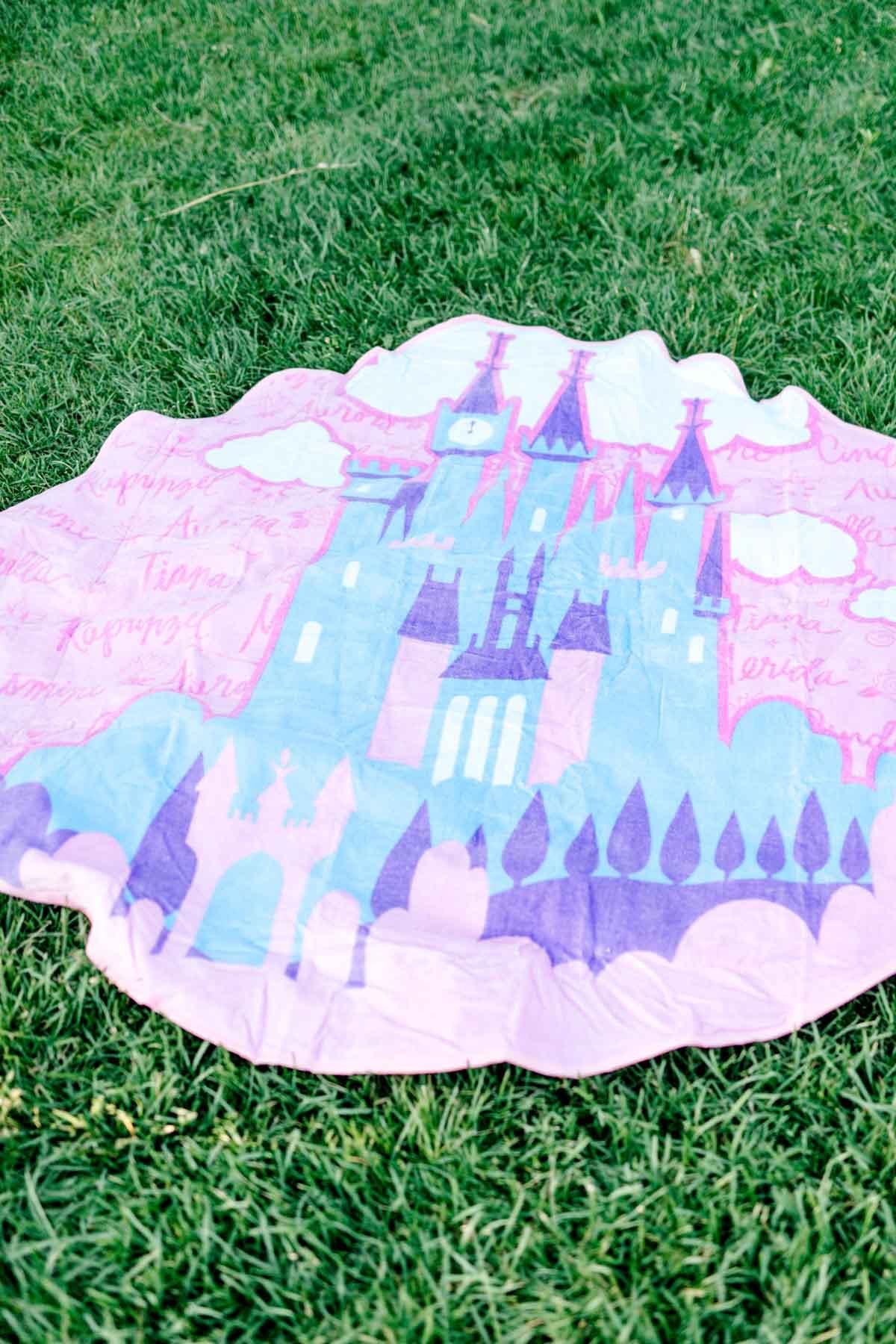 princess beach towel on grass