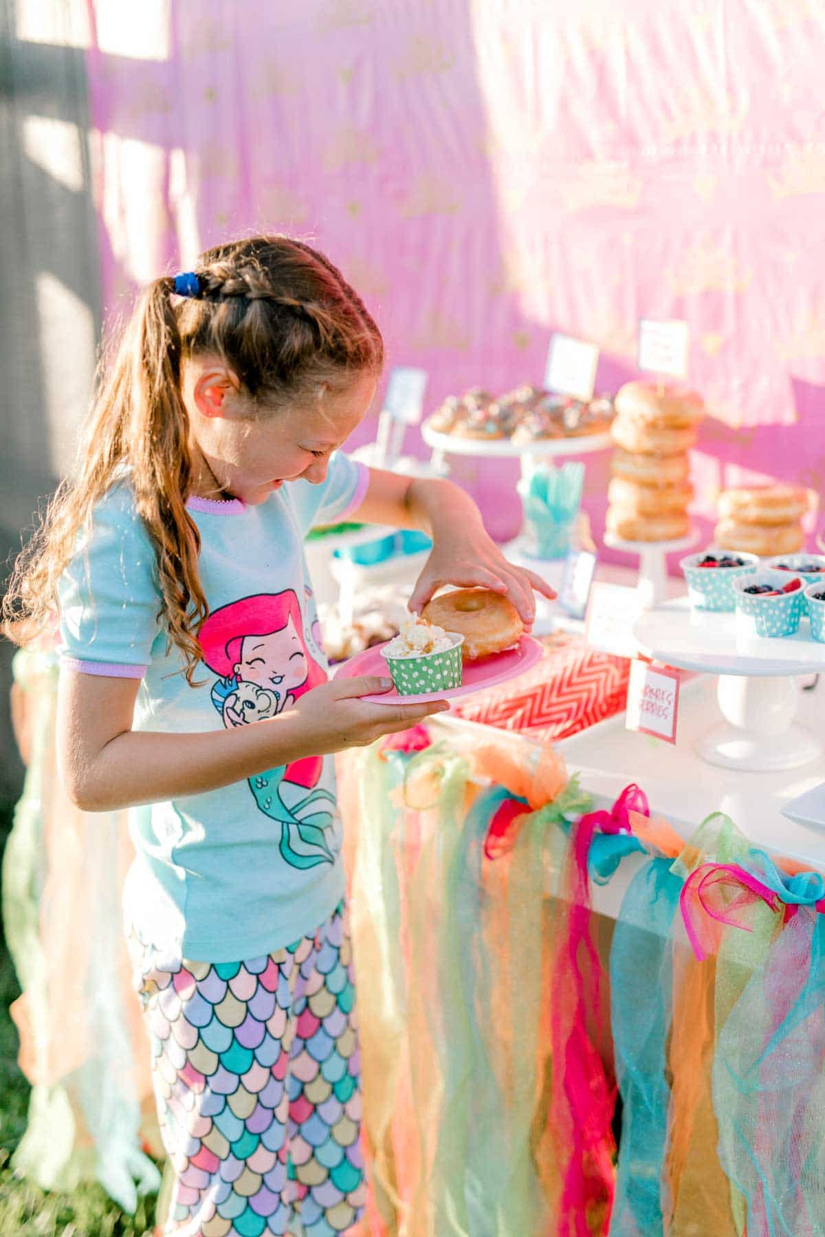 girl standing at a princess party table