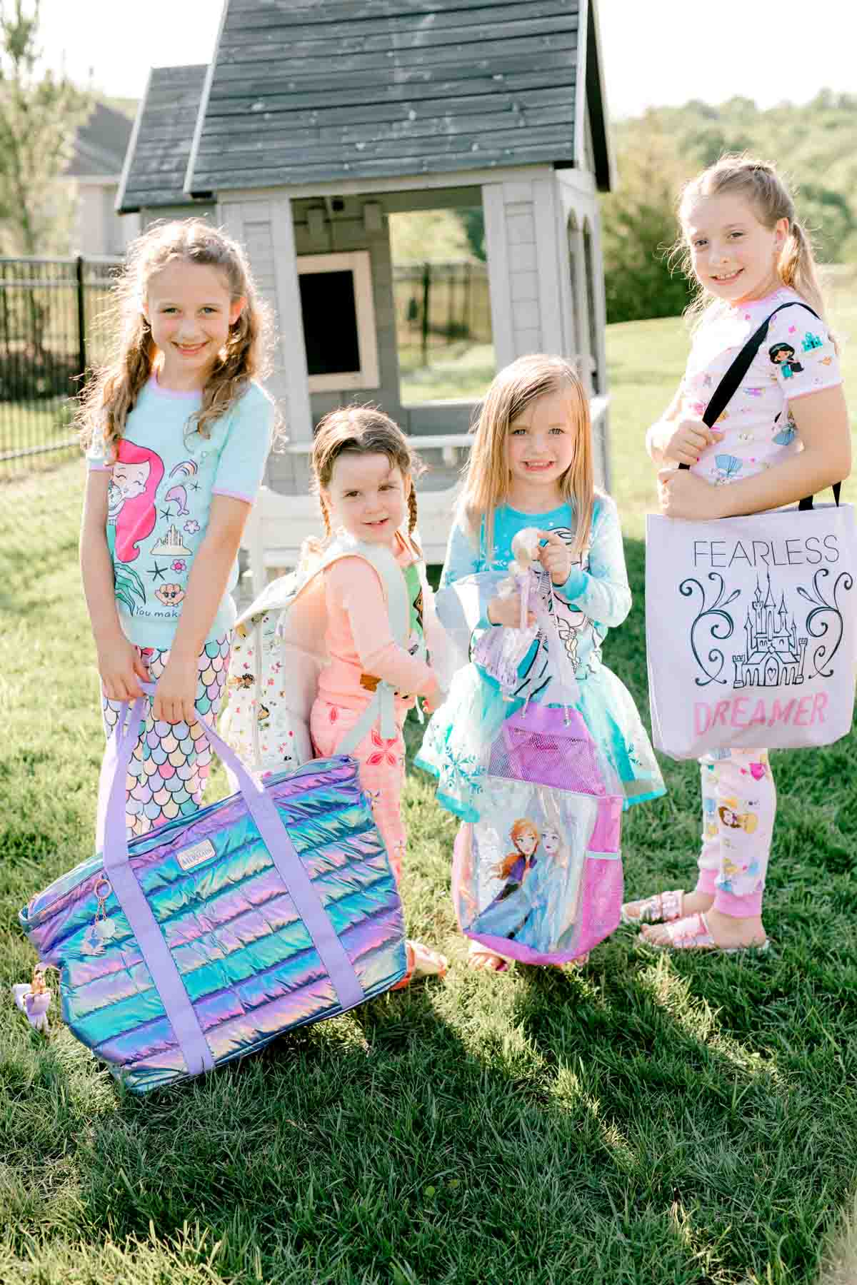 girls holding princess bags