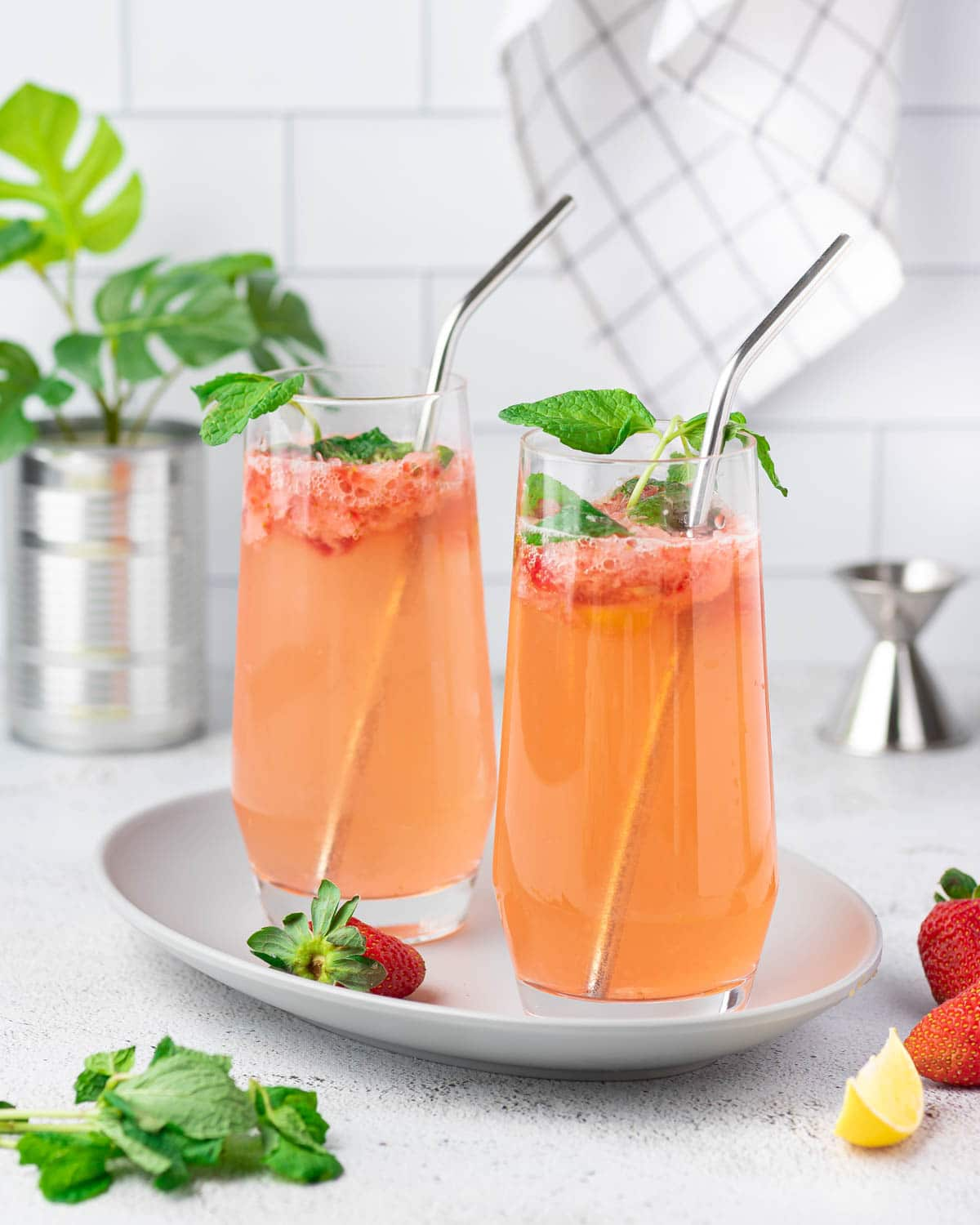 Two glasses of strawberry mojito mocktail with straws