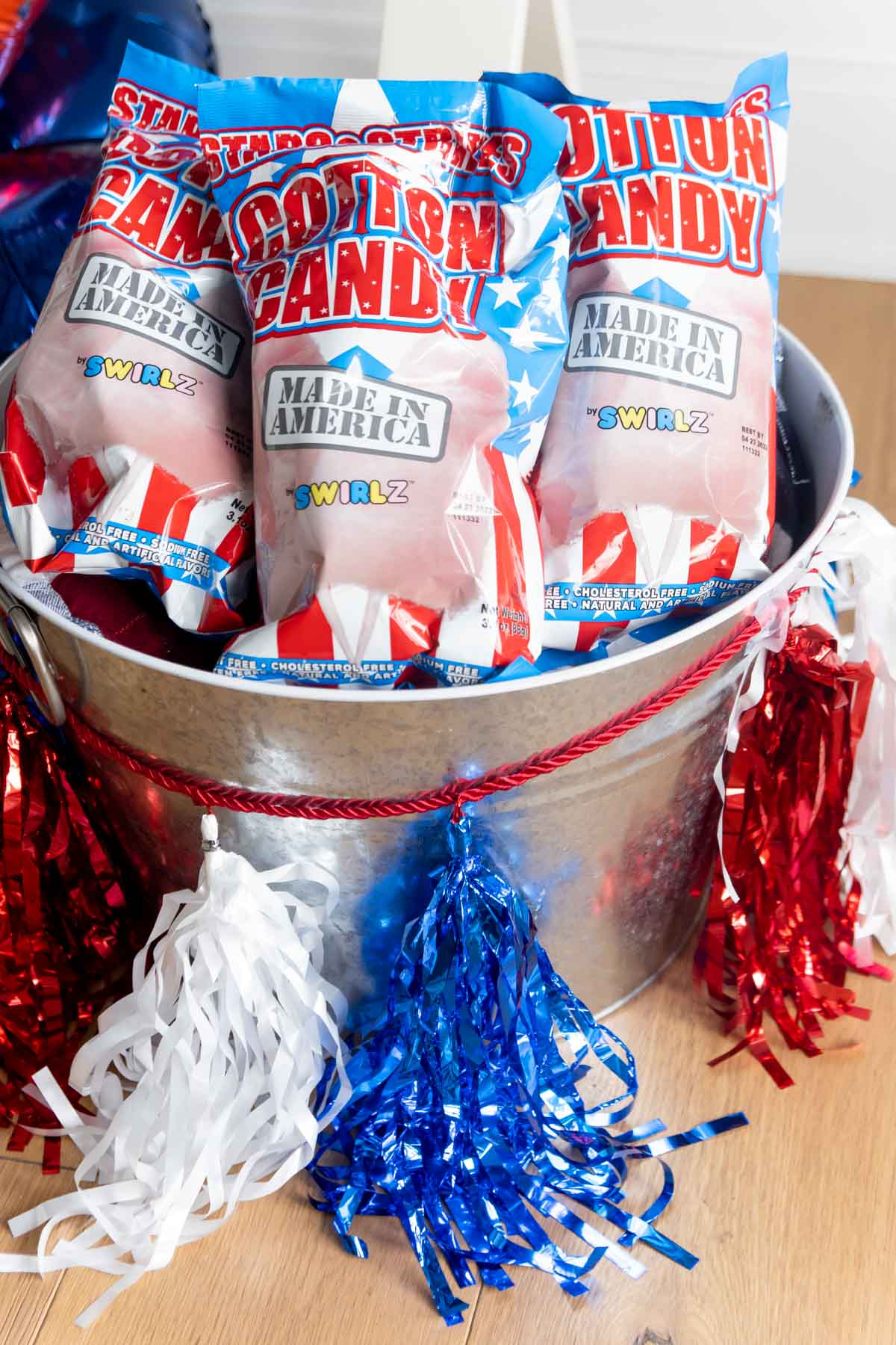 metal bin with cotton candy bags