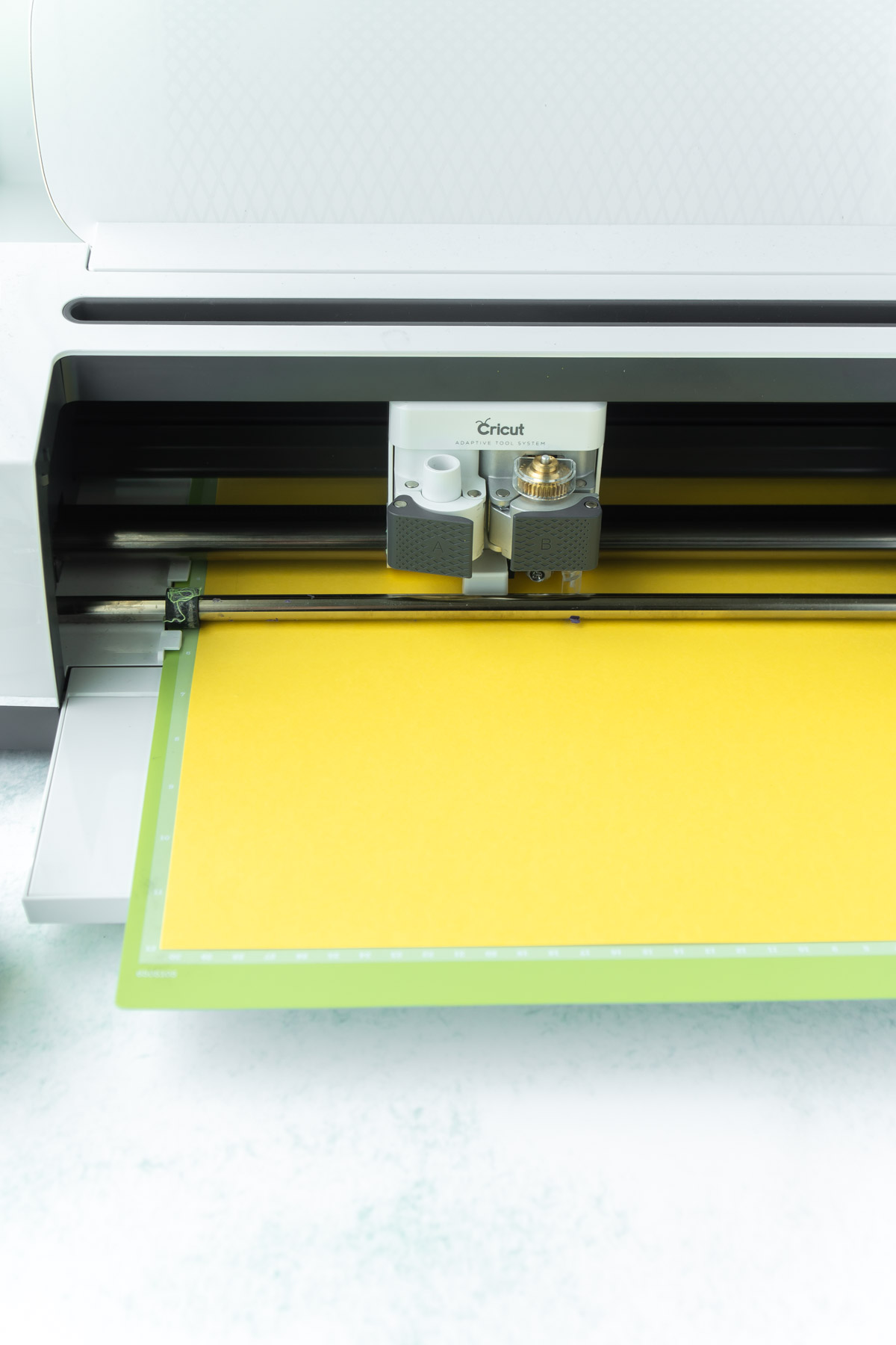 Cricut Maker loaded with yellow card stock