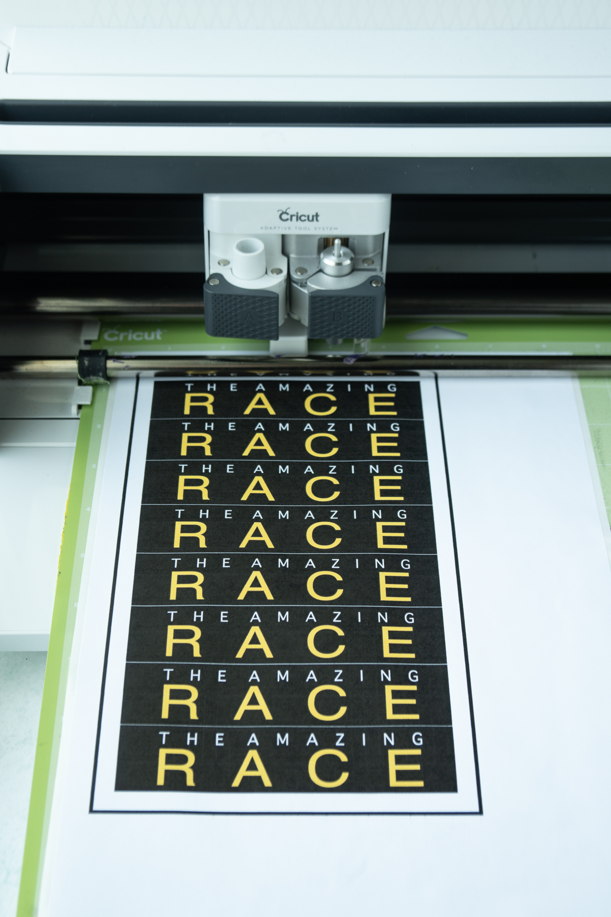 Amazing Race envelope stickers loaded onto a Cricut Maker