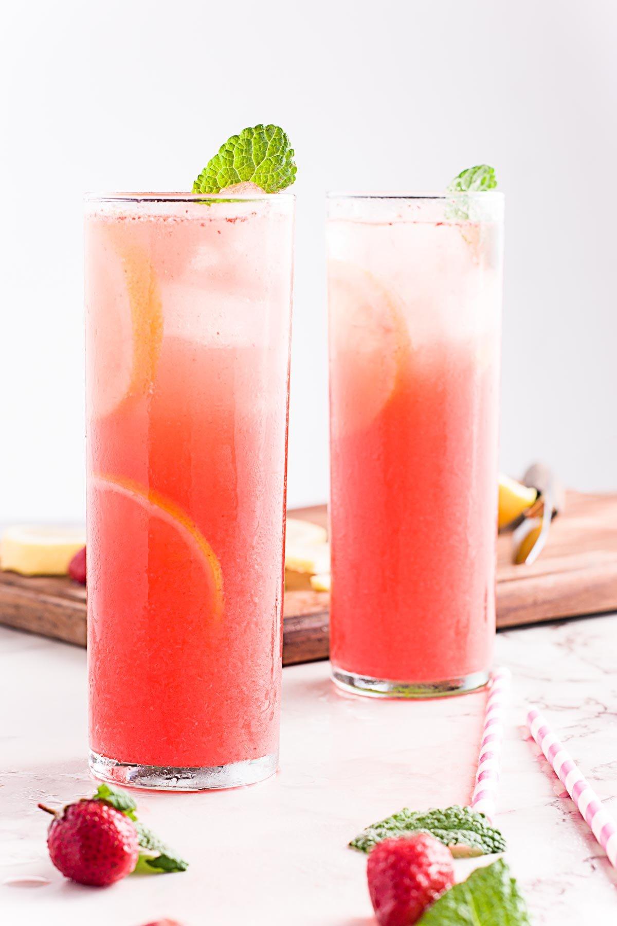 Two glasses of homemade strawberry lemonade