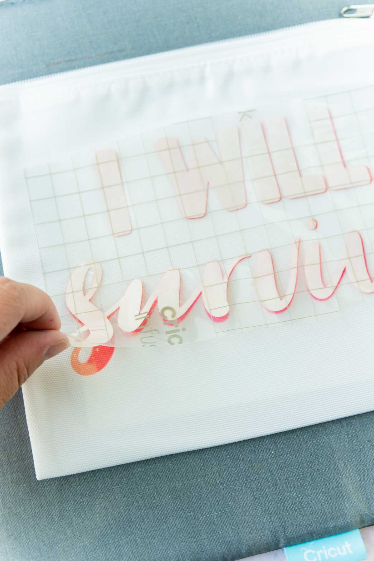 hand peeling backing off of Cricut Infusible Ink