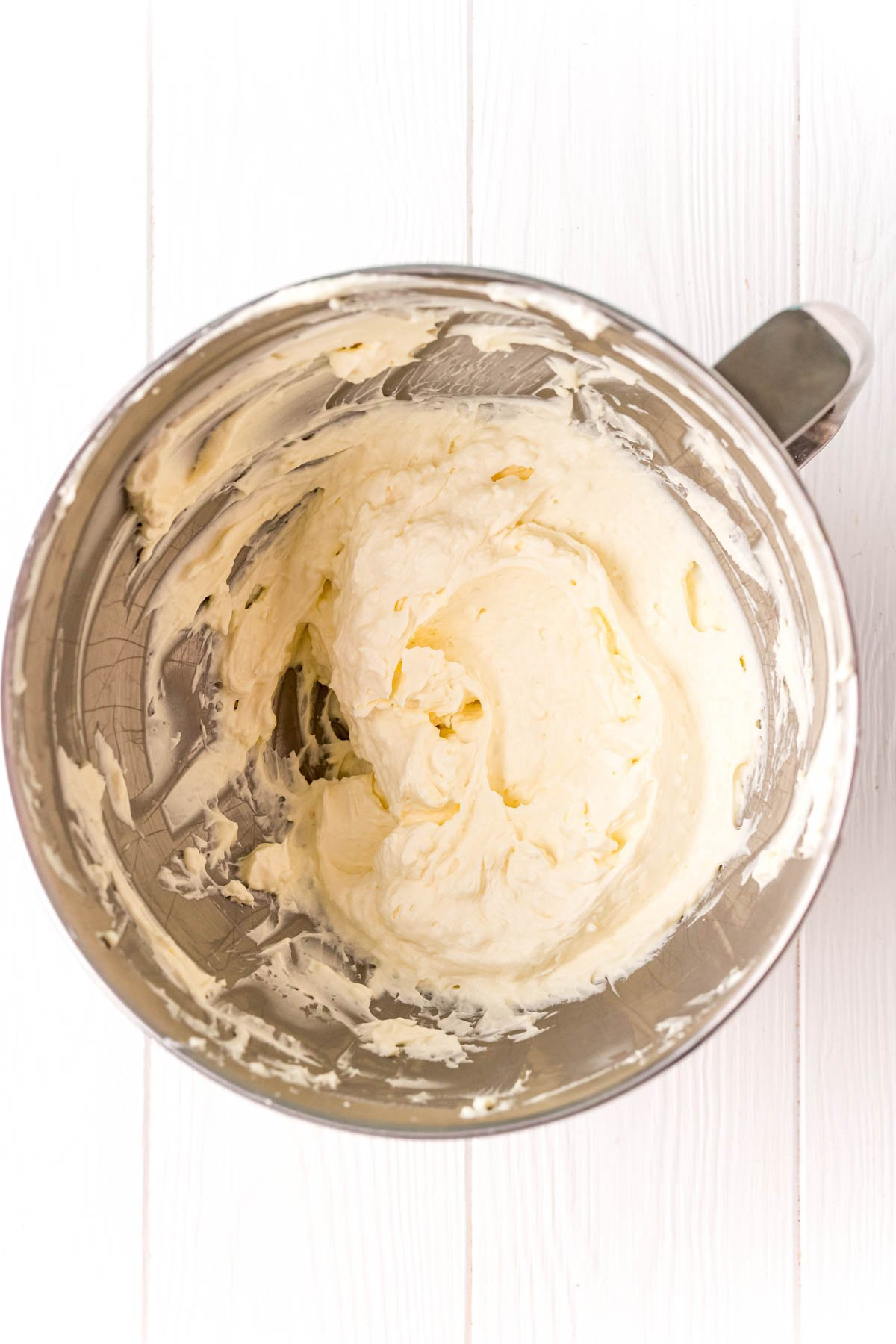 Whipped cream in a metal bowl
