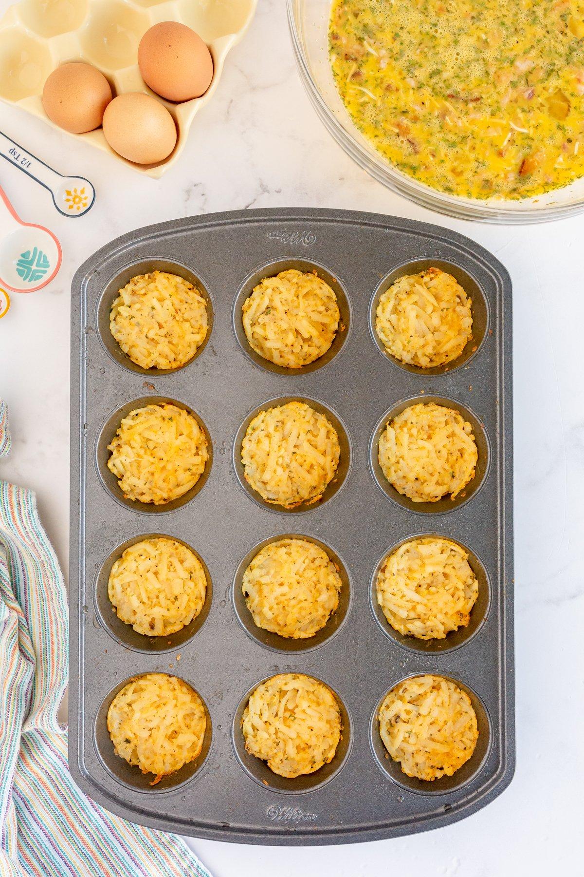 hash brown crusts in a muffin tin