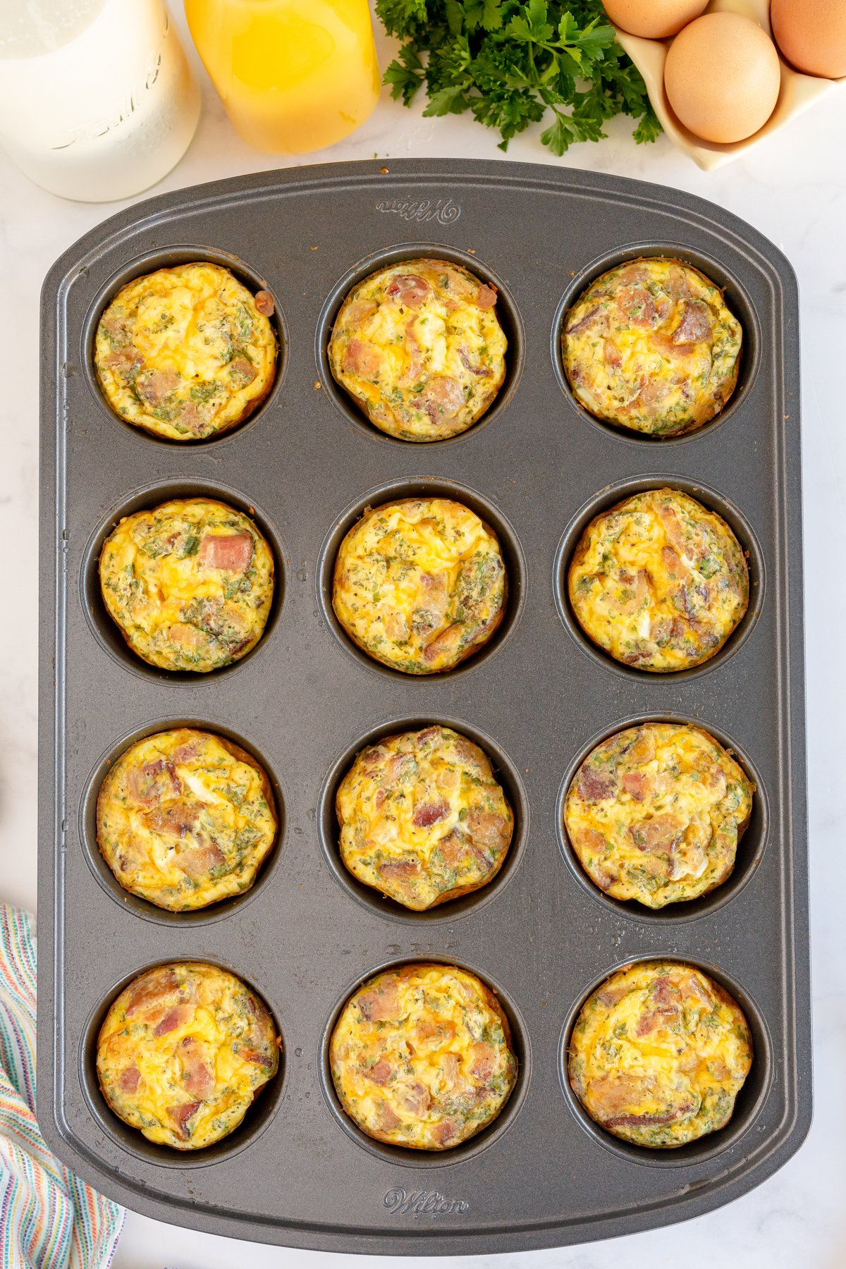 uncooked breakfast muffins in a muffin tin
