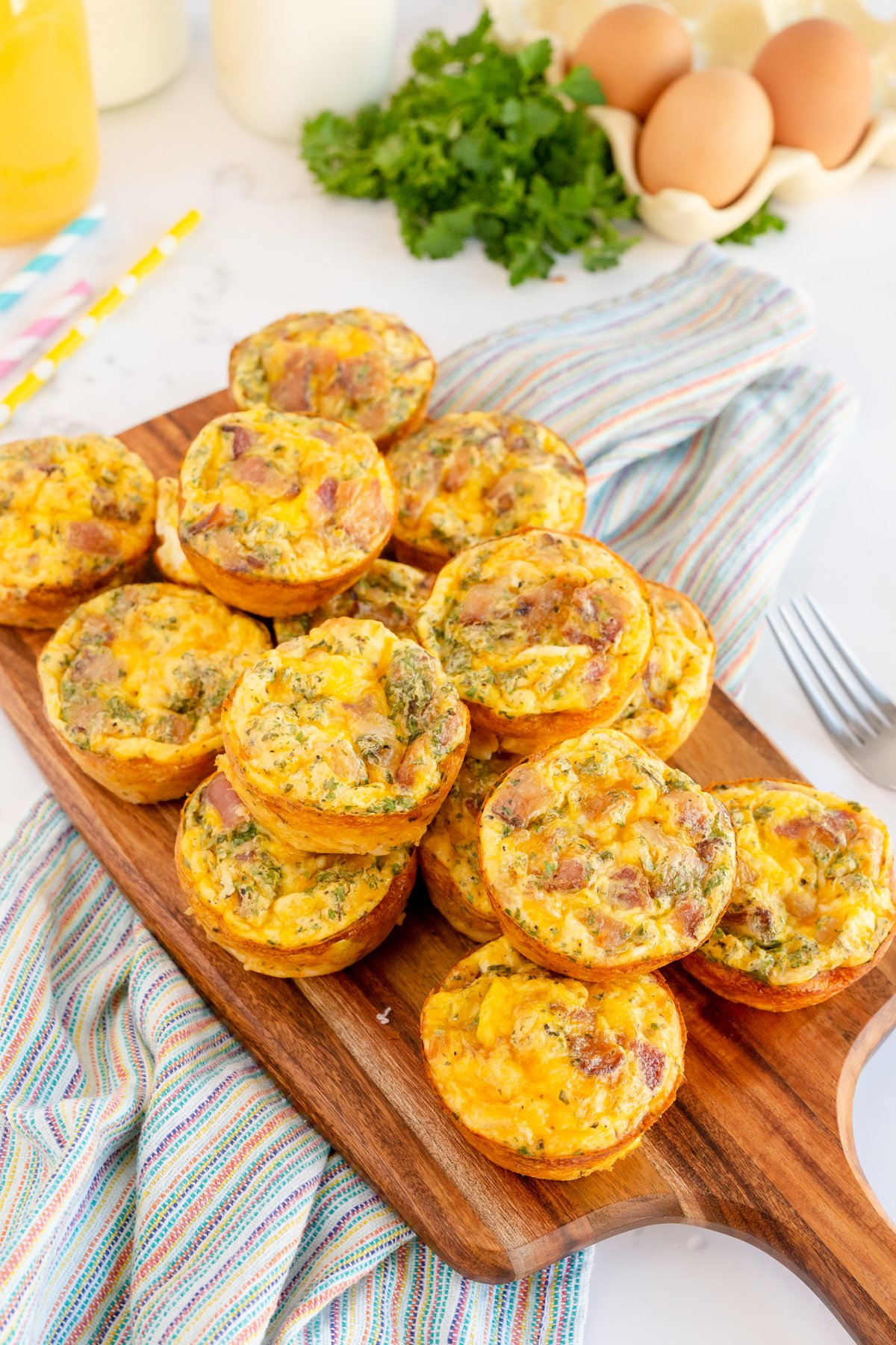 stack of breakfast muffins on a wood cutting board