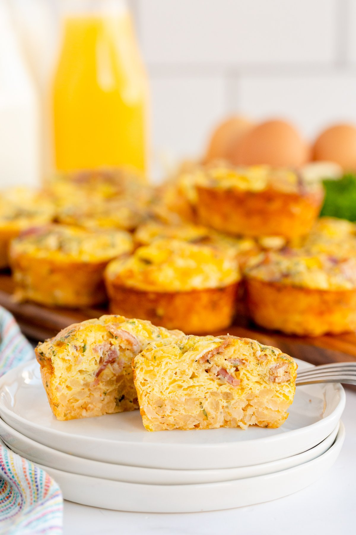 breakfast muffins on a white plate cut in half