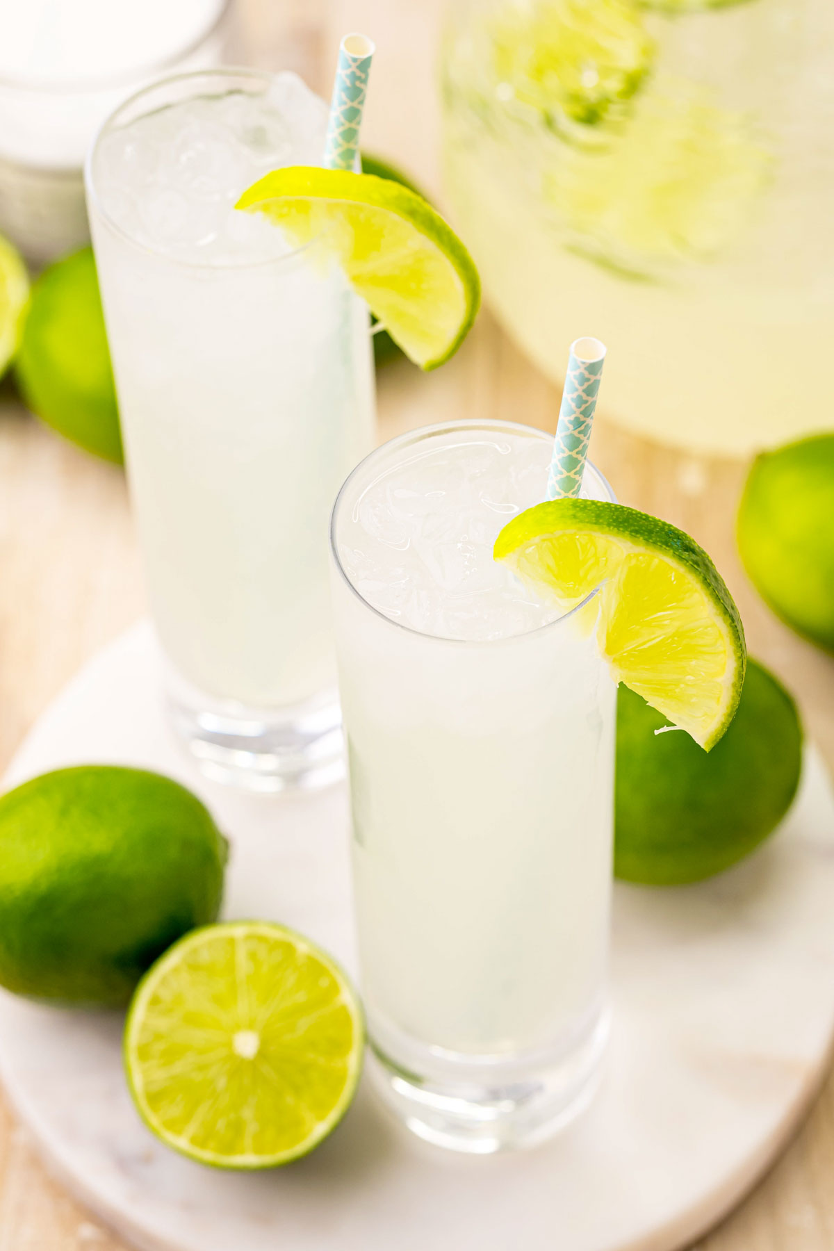 two glasses of homemade limeade with straws
