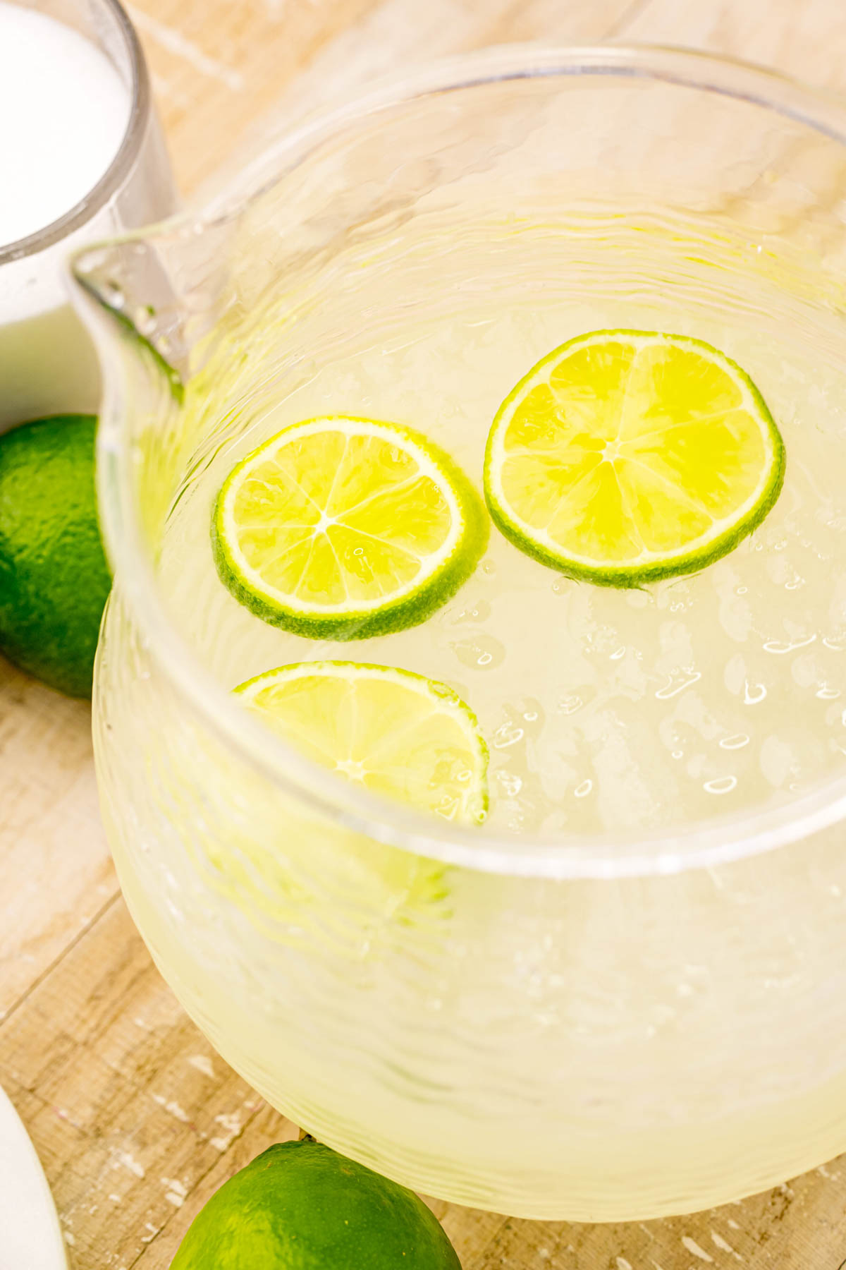 top view of homemade limeade in a glass pitcher