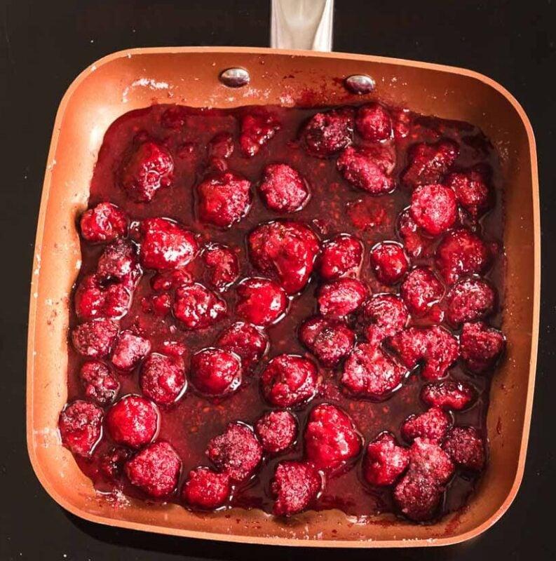 raspberries and sugar in a saucepan
