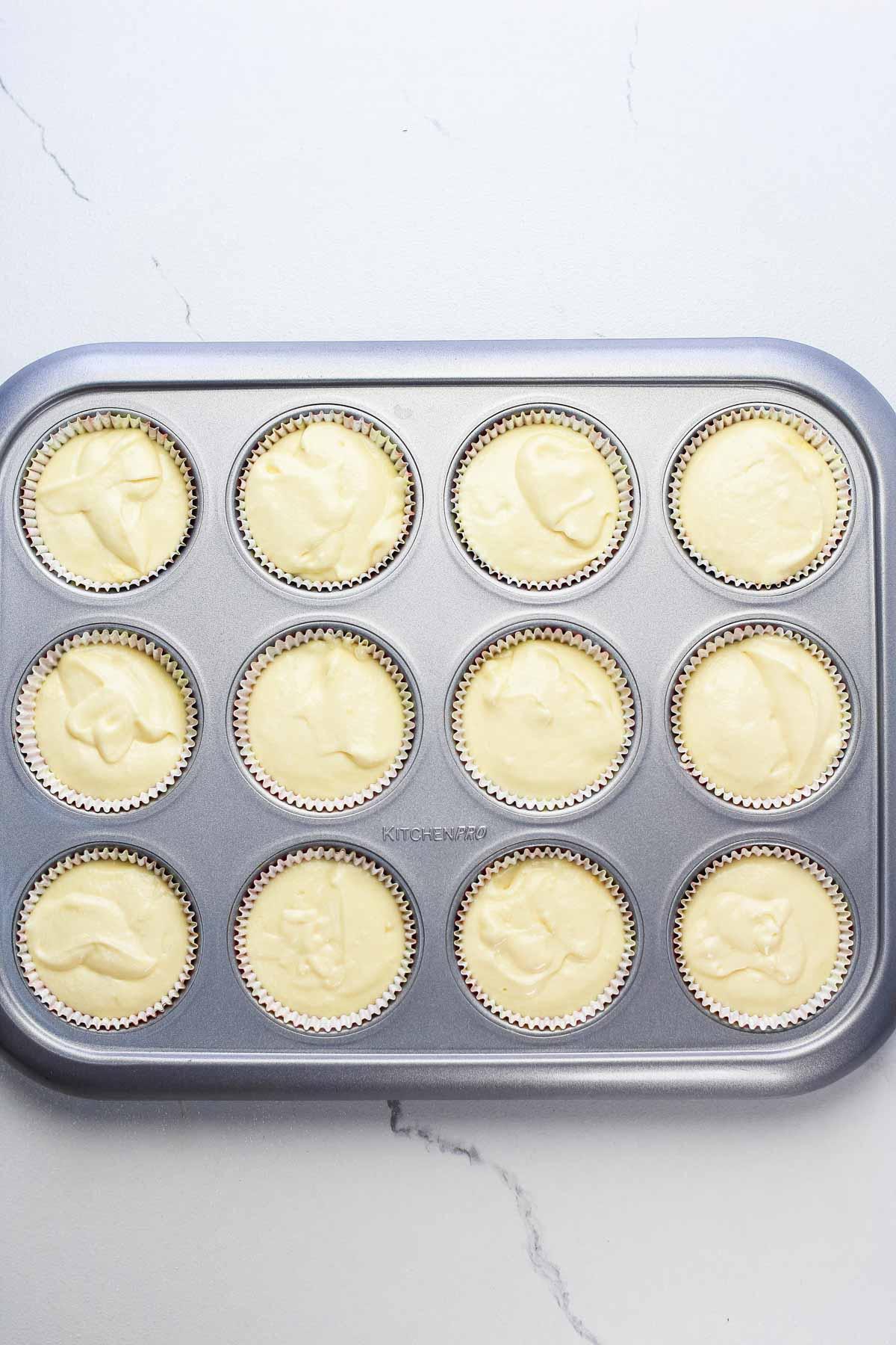 unbaked lemon cupcakes in cupcake pan