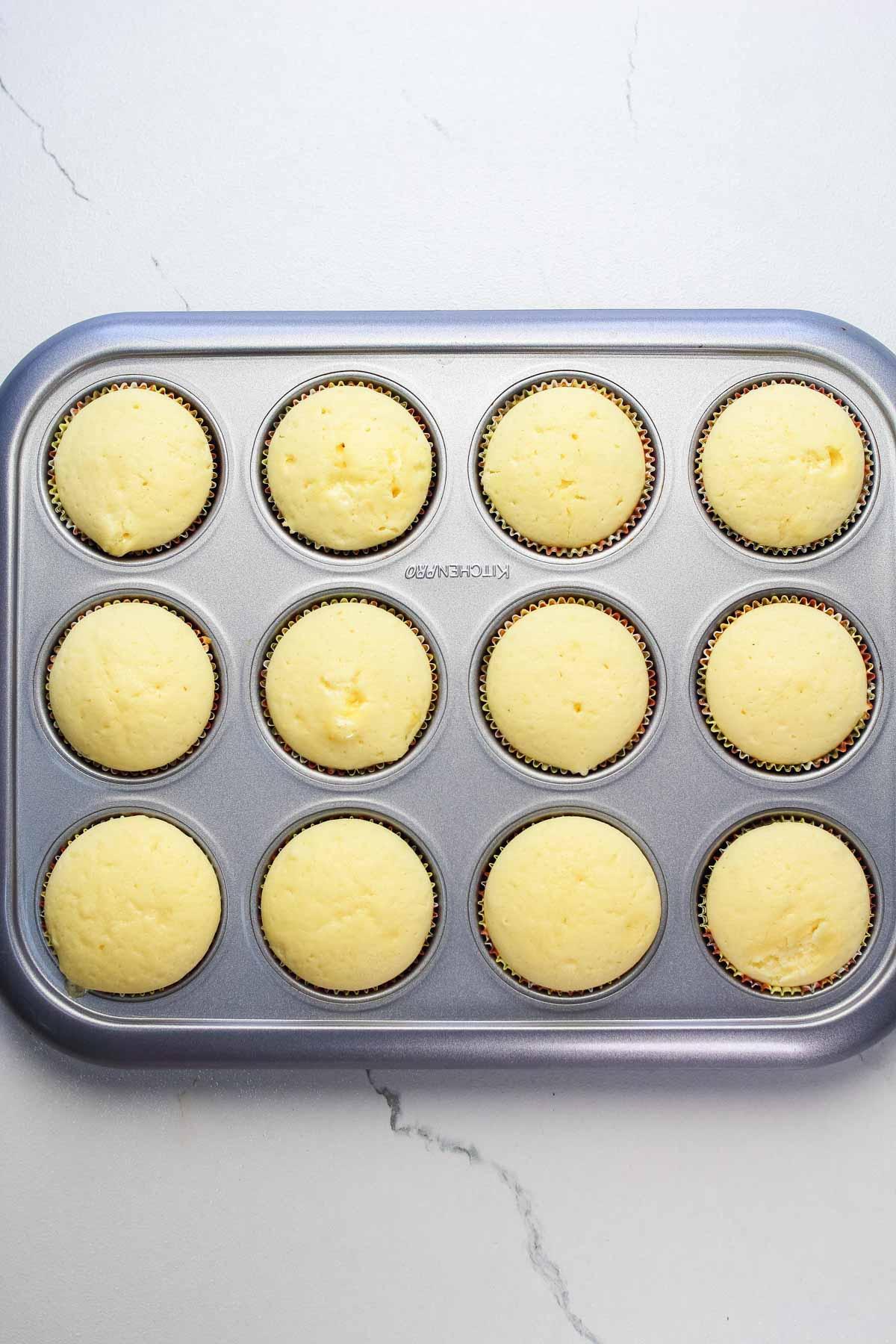 Baked lemon cupcakes still in the cupcake pan