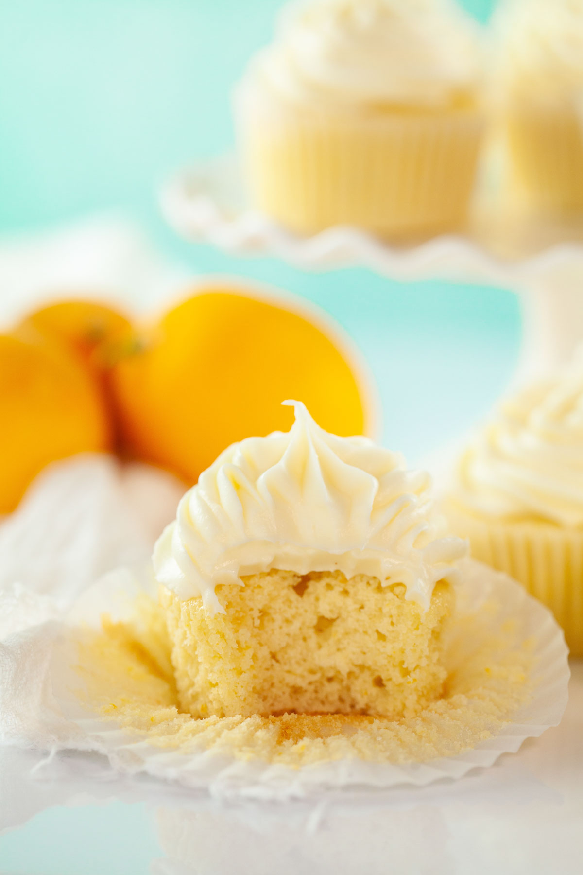 lemon cupcake with a bite taken out of it