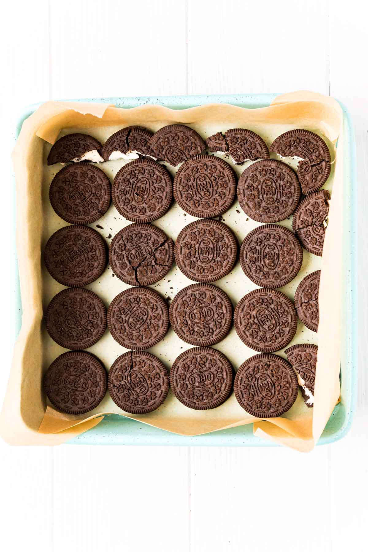 line of Oreos on the bottom of a square pan