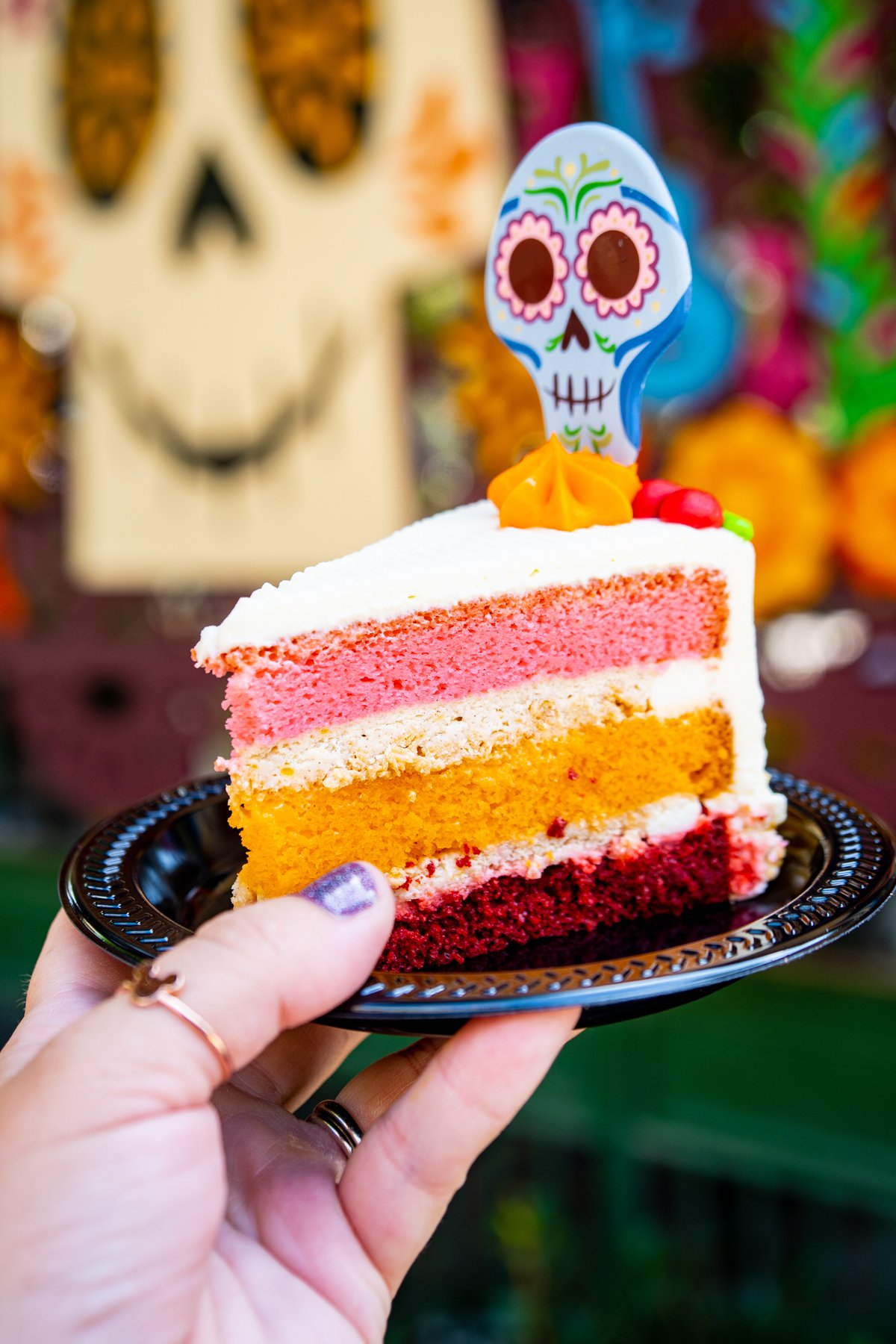layered cake with pink and orange layers