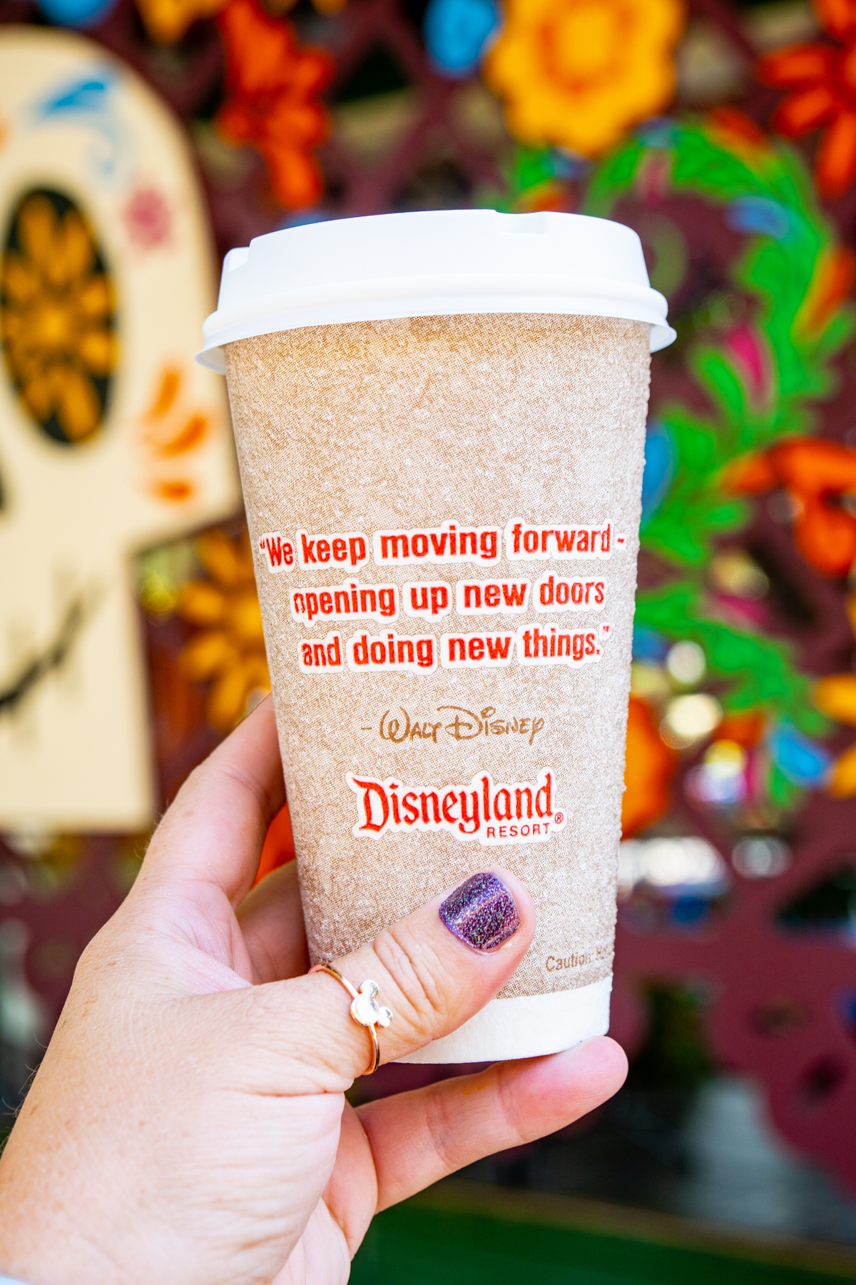 hand holding a Disneyland hot chocolate cup